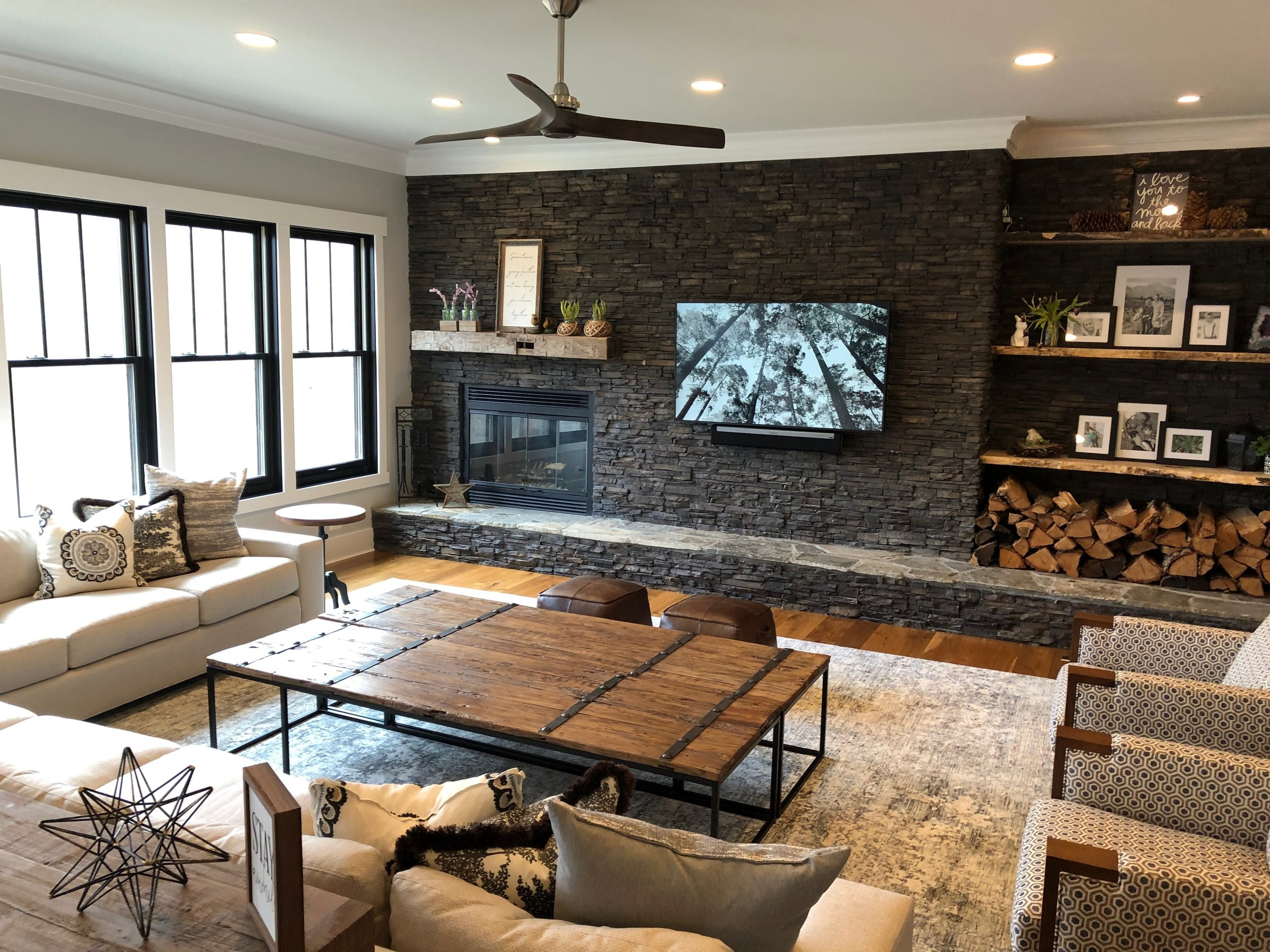 Family room with an off-center fireplace.