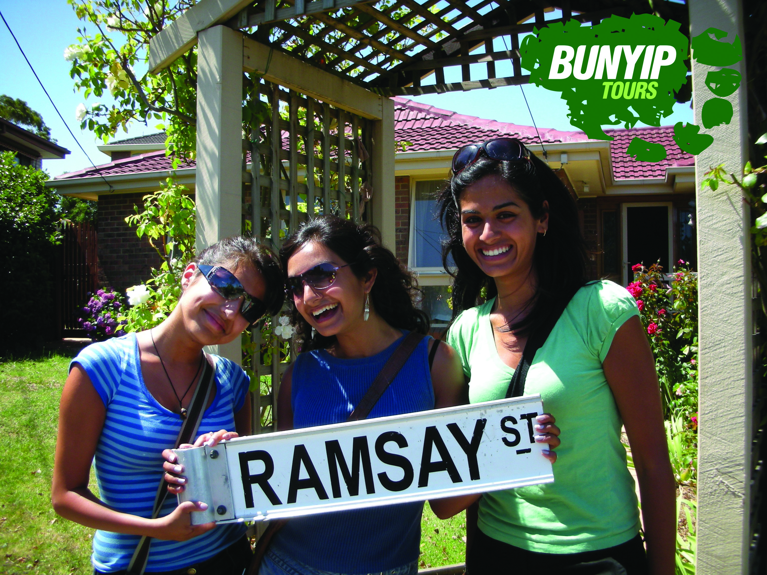 Fans holding Ramsay St Sign