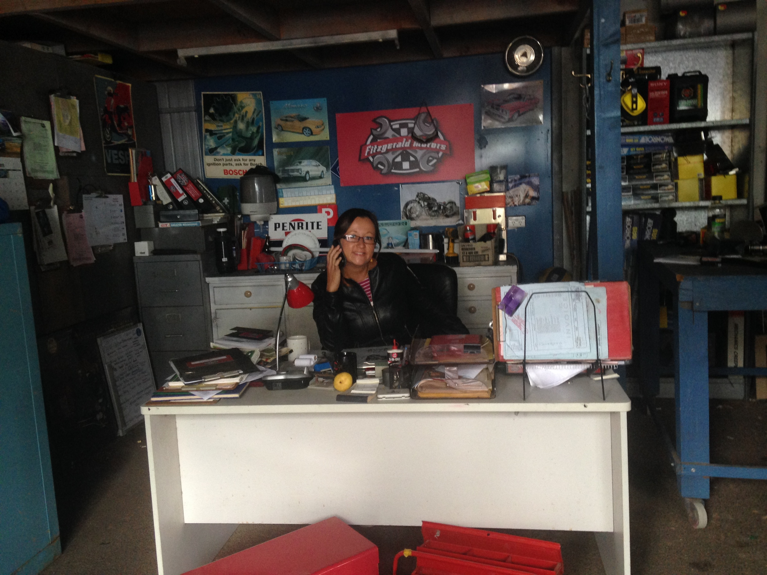 10. Emma Wright posing at Fitzgerald Motors on the set of Neighbours.JPG