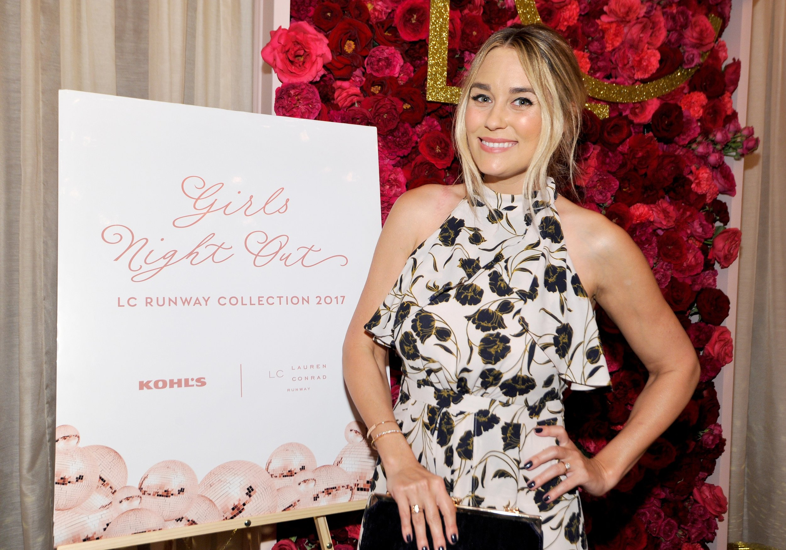 Lauren Conrad at her Girls Night Out event in front of a Yellow Heart Art welcome sign.