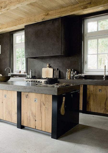 Black concrete makes a rich contrast to light wood cabinetry