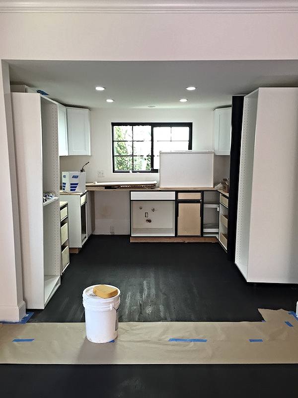 My beautiful black floors after the first coat of stain.