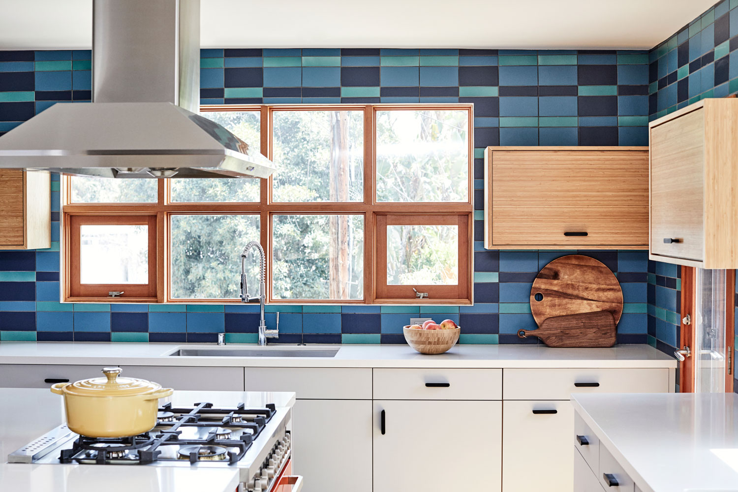A custom-blend of Fireclay Tile in a surprising plaid pattern made the mid-century modern statement our clients' wanted.
