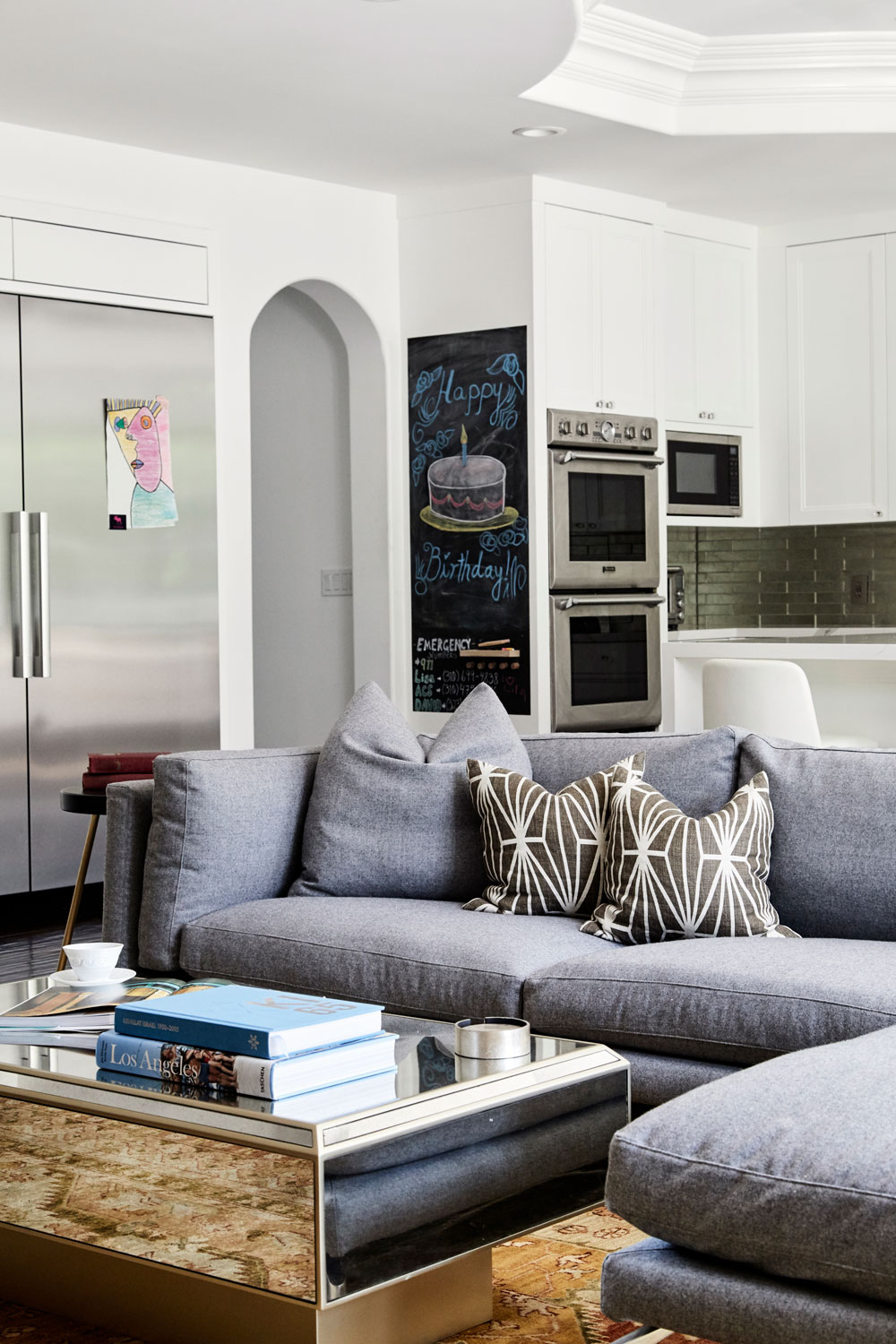 The repetition of silver and mirrored-finishes made the great room and kitchen feel cohesive, fresh and sophisticated.