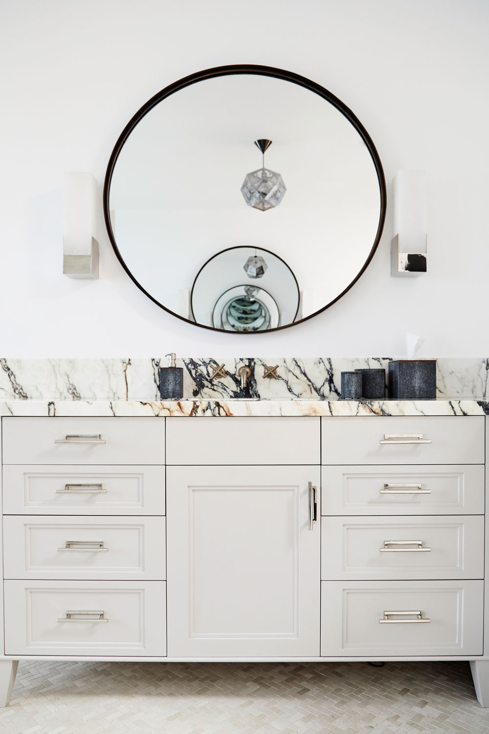 Oversized bronze mirrors framed by polished nickel sconces from Kelley Wearstler. Who says you can't mix metals?