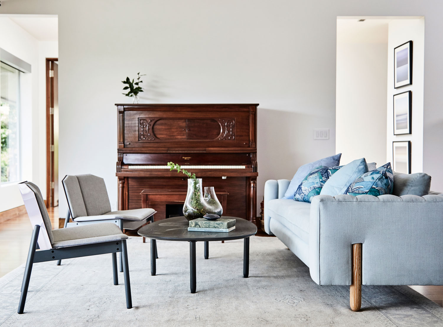 Pairing our client's antique player piano with modern pieces from Lawson Fenning and Blu Dot was one of the ways we integrated their family history with the contemporary style of their new home.