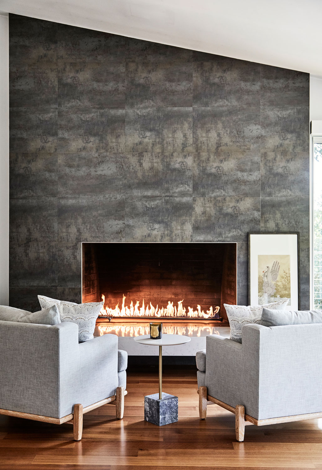 Clean but substantial chairs from Lawson Fenning hold their own against this dramatic fireplace.