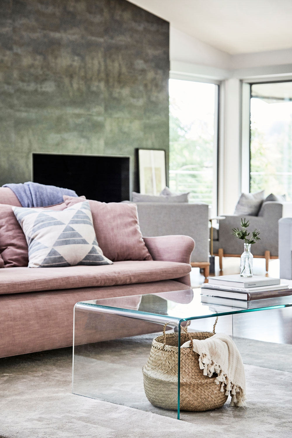 This sophisticated pink creates a lovely warmth against all the blues, grays, and greens in the rest of the room.