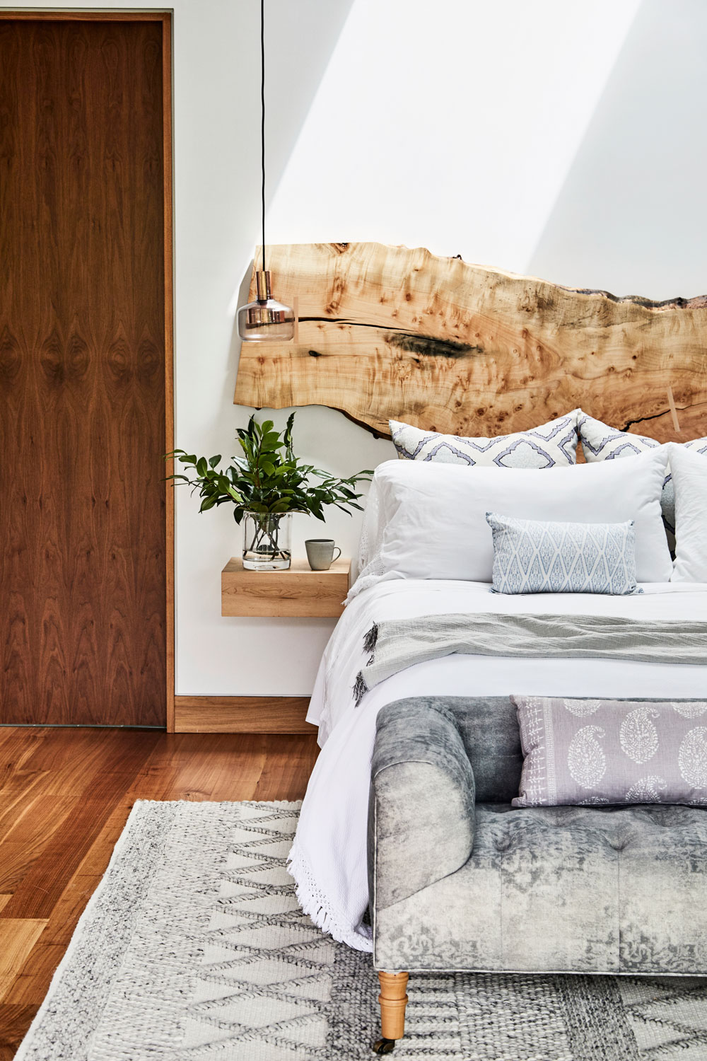 Stranger Furniture's splayed maple headboard and floating nightstands are heavenly in this room.