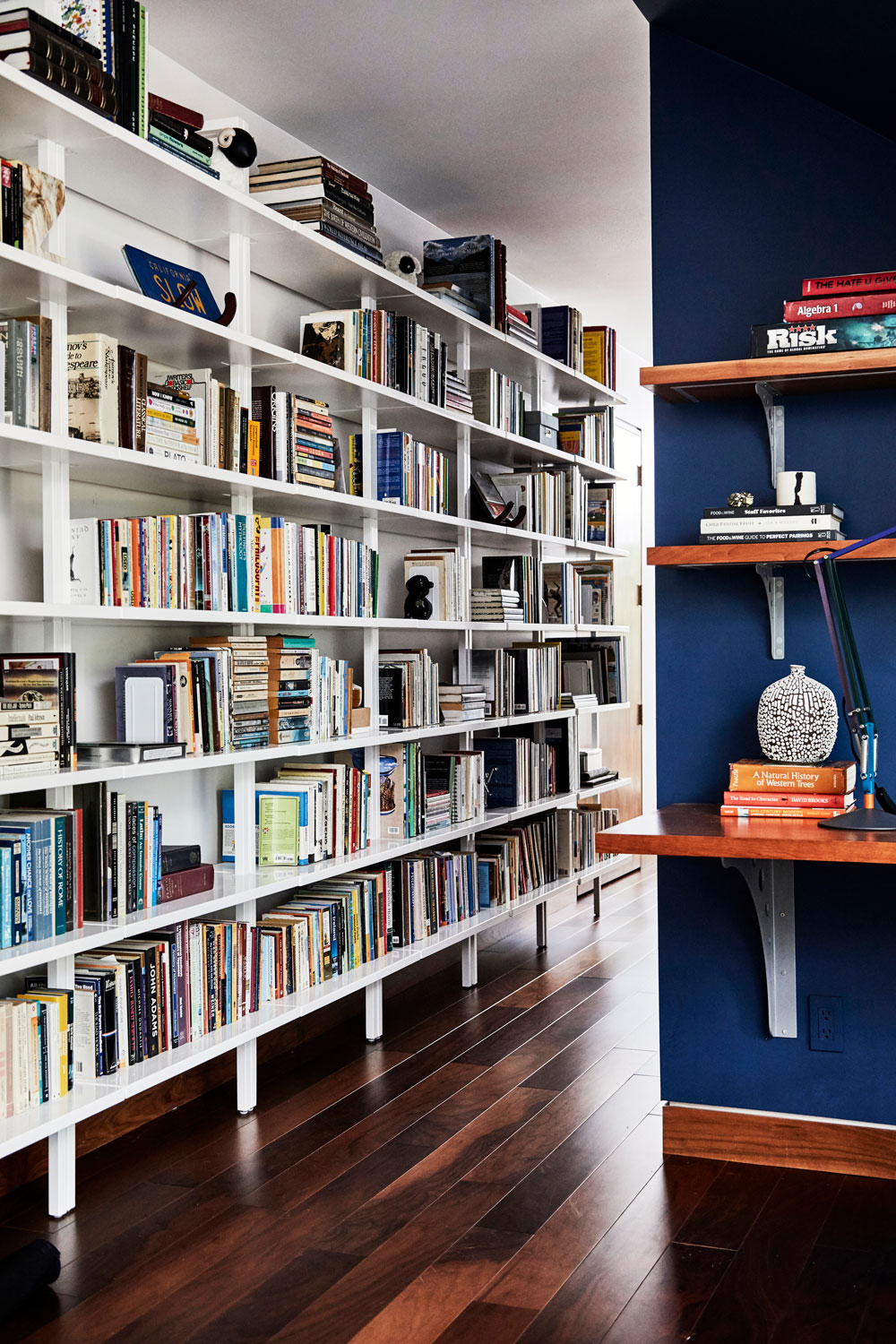 Eleven of these wall-mounted bookcases meant our client's library had a new home.