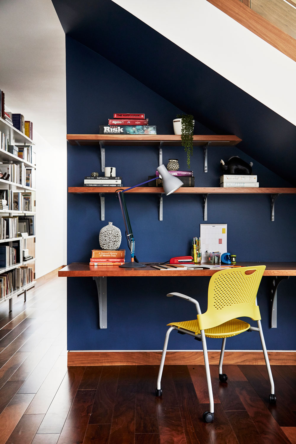 This deep blue makes this homework spot under the stairs feel like a room all it's own.