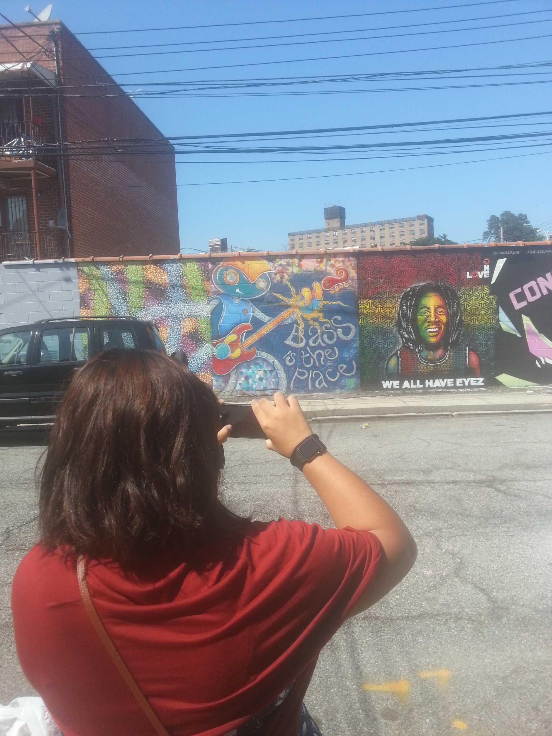 Native Creative Concierge client snapping pic of street art seen on a recent excursion to Welling Court