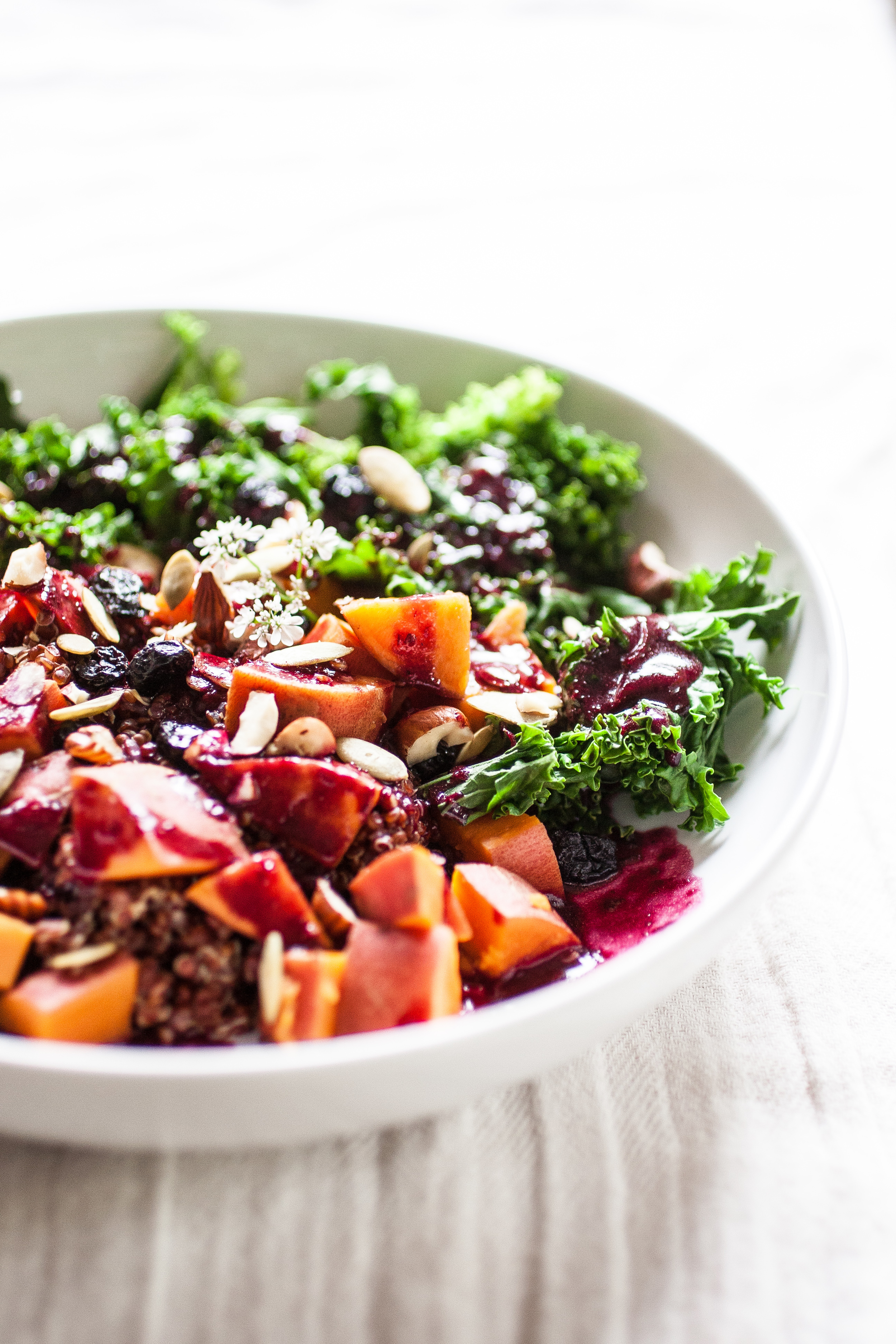 Produce On Parade - Sweet Potato & Blueberry Forest Bowl - An easy and incredibly healthy dinner. Nuts, seeds, and dried berries adorn sweet potato, quinoa, and kale that's drizzled with a homemade blueberry vinaigrette.