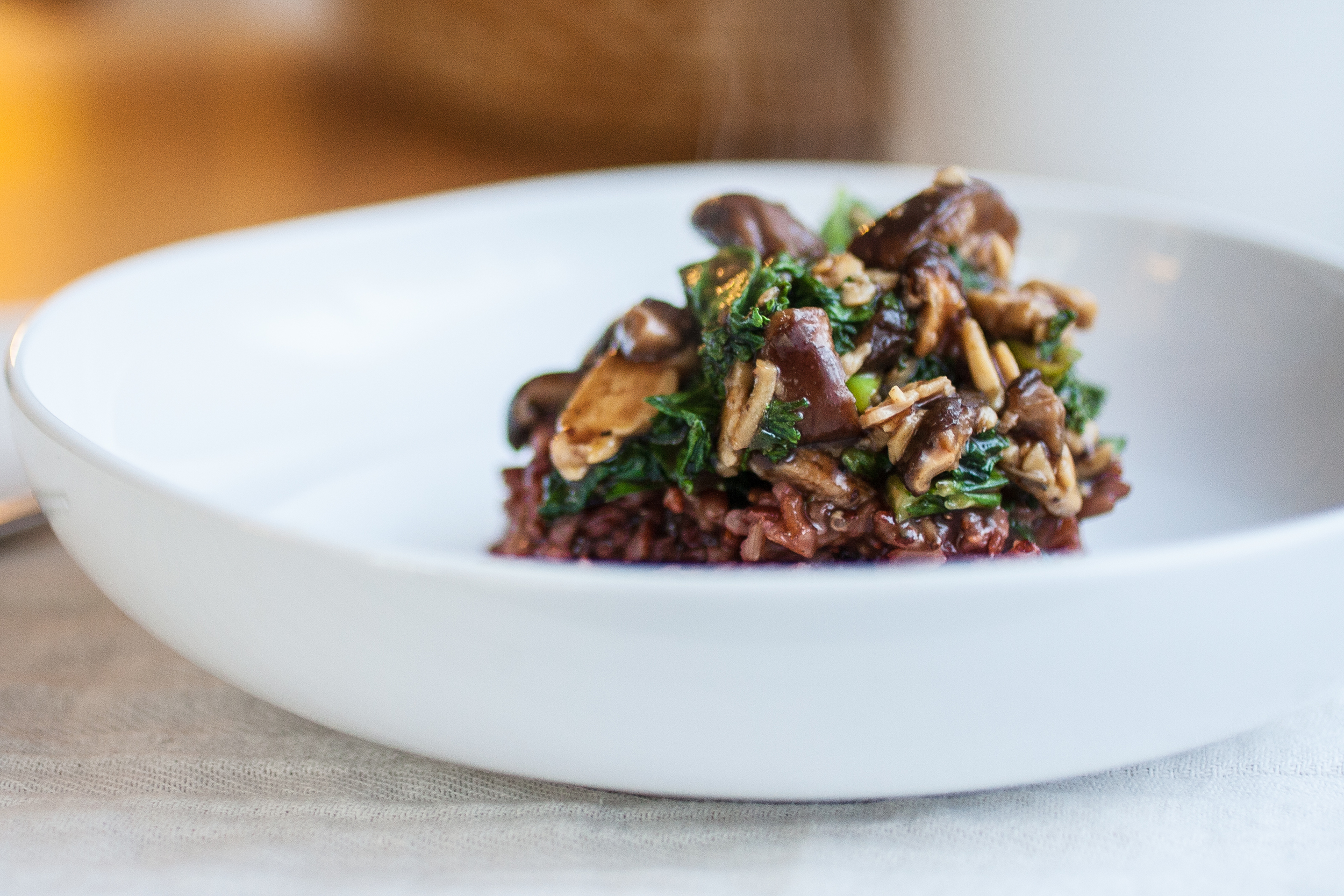 Produce On Parade - Shiitake Tempeh and Kale Stir-Fry - This is delicious stir-fry of marinated tempeh, rich shiitake mushrooms, and sautéed kale in a garlic-ginger sauce, over red rice.
