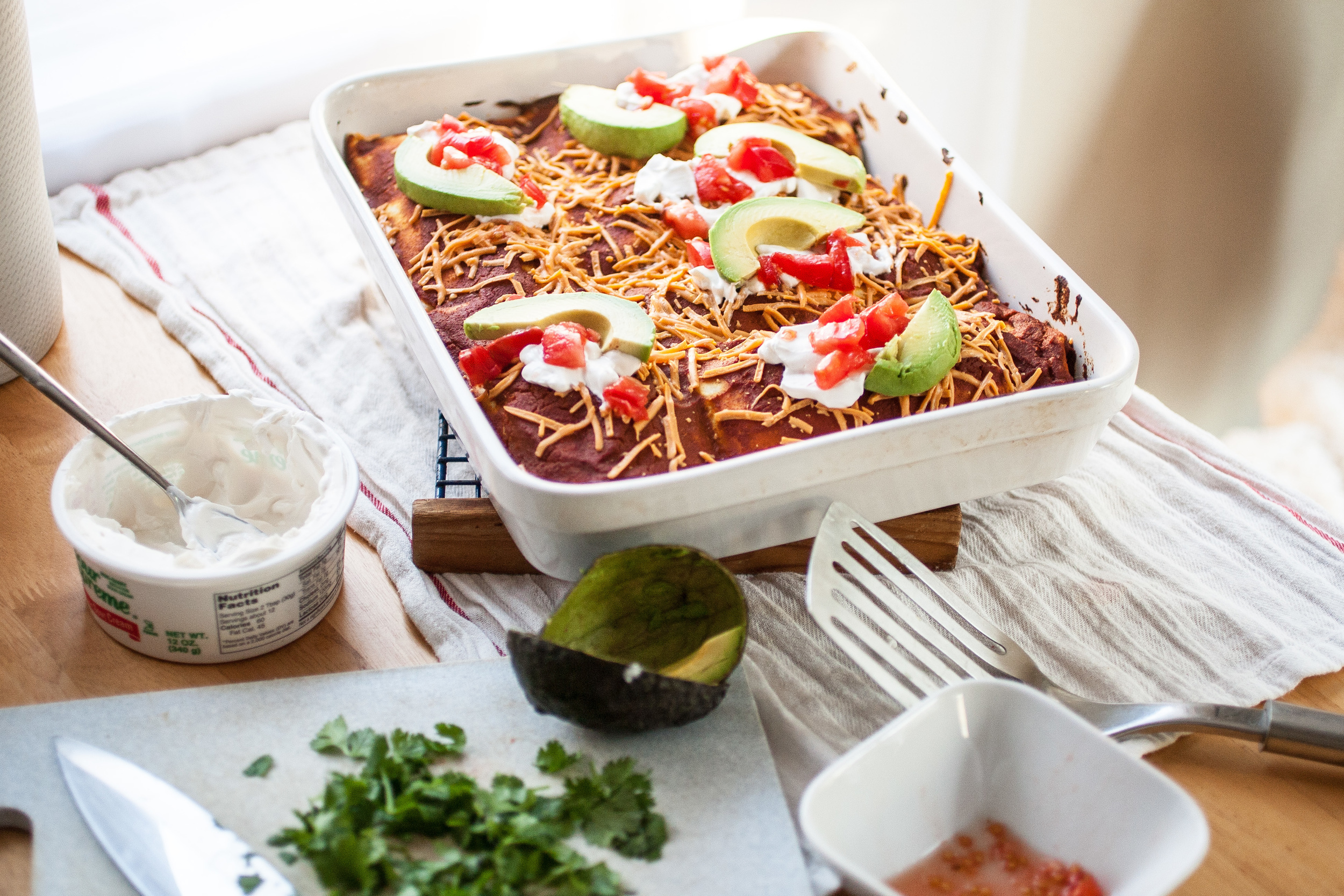 Produce On Parade - Black Bean, Corn & Red Rice Enchiladas - These are vegan, cheesy enchiladas made with a from scratch enchilada sauce. They're easy and full of good for you vegetables!