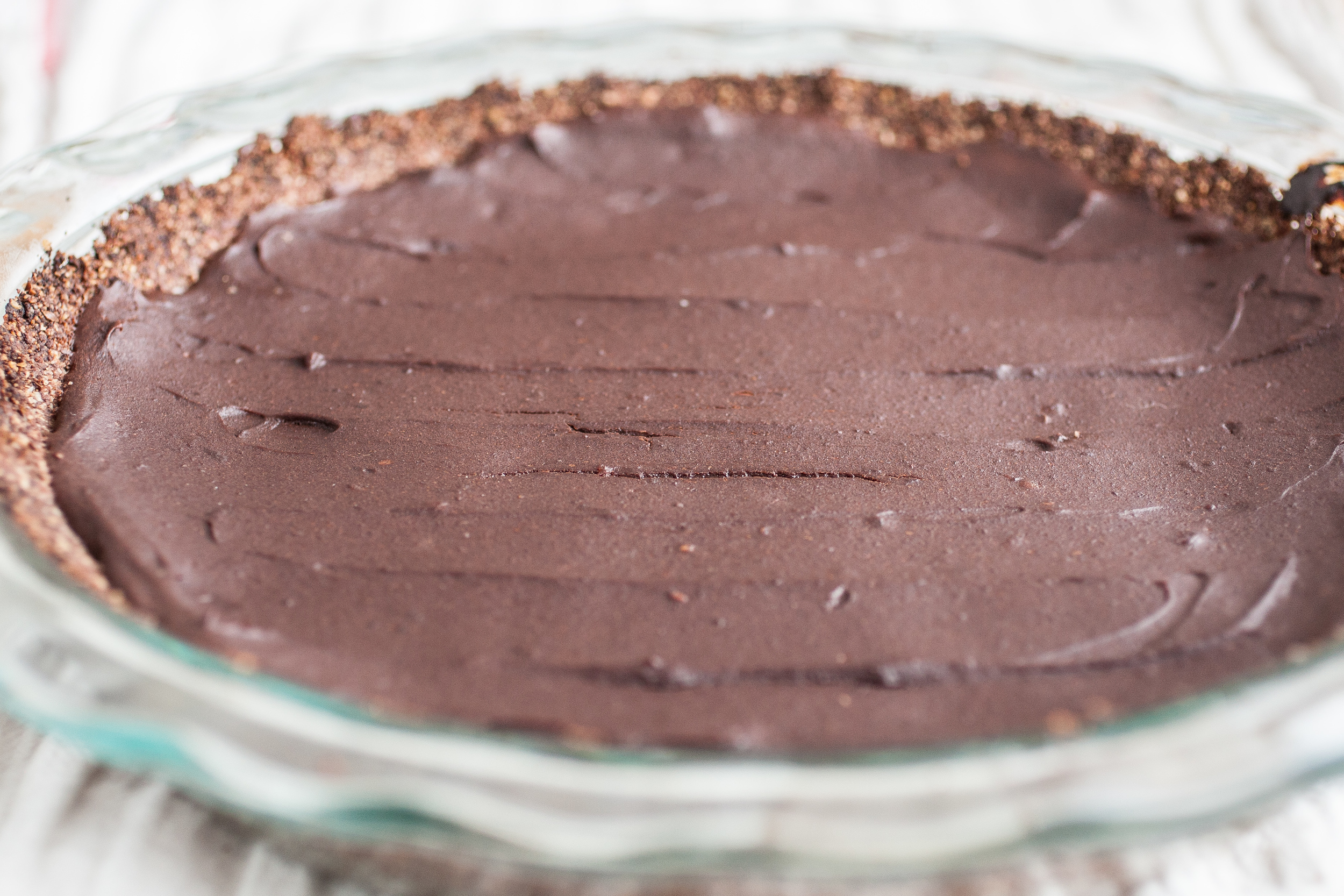 Produce On Parade - Chocolate Caramel Silk Pie - This fudgy chocolate pie is sweetened with caramelly dates with a cocoa, almond, & oat crust. Vegan and added sugars-free!