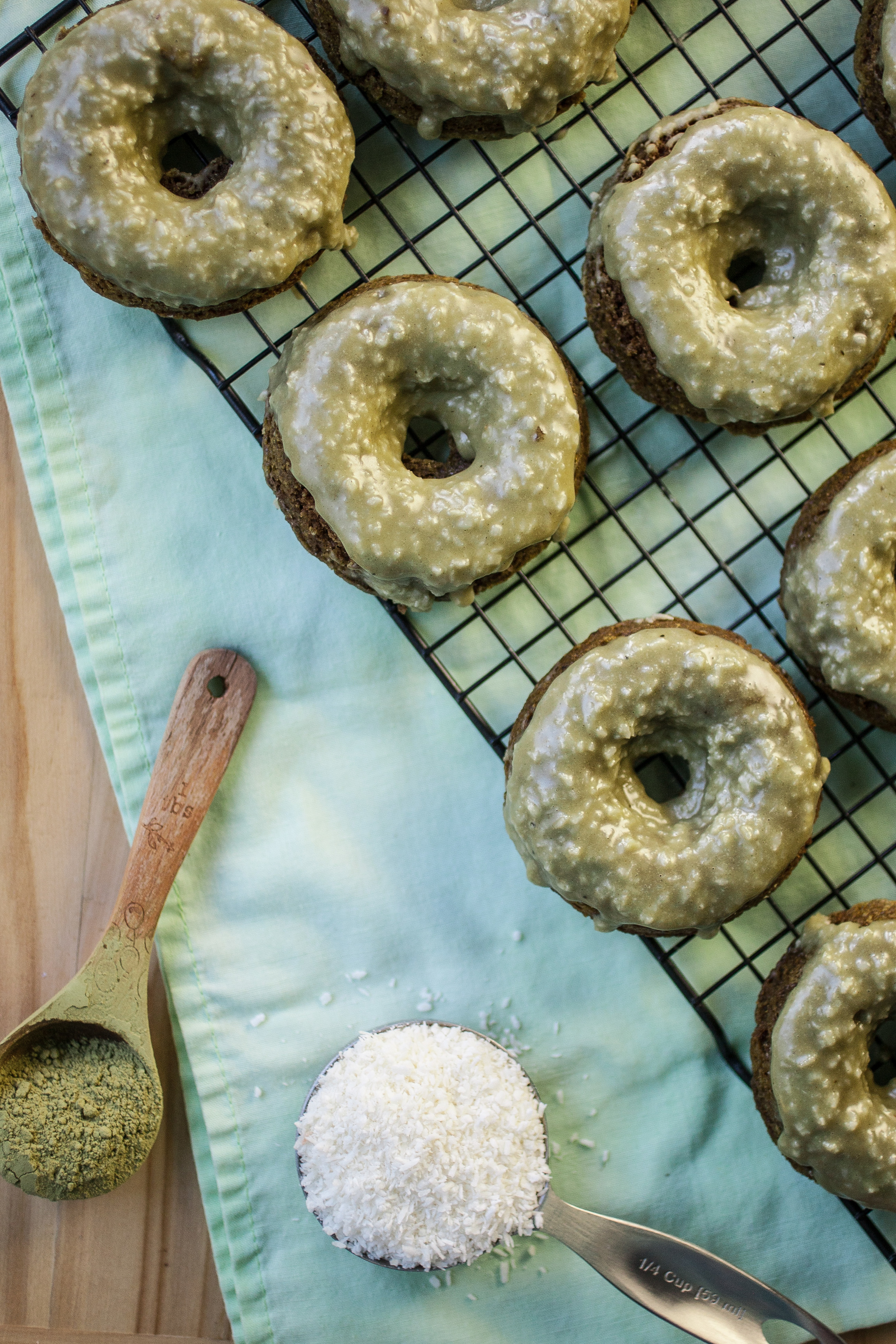 Produce On Parade - Green Tea Doughnuts w/ Crunchy Coconut Glaze - Baked doughnuts with powdered green tea mixed right in the batter! Adorned with a sweet and crunchy coconut-nutmeg glaze, these are easy to make and brimming with green tea flavor. A perfect and unique treat for St. Patrick's Days!