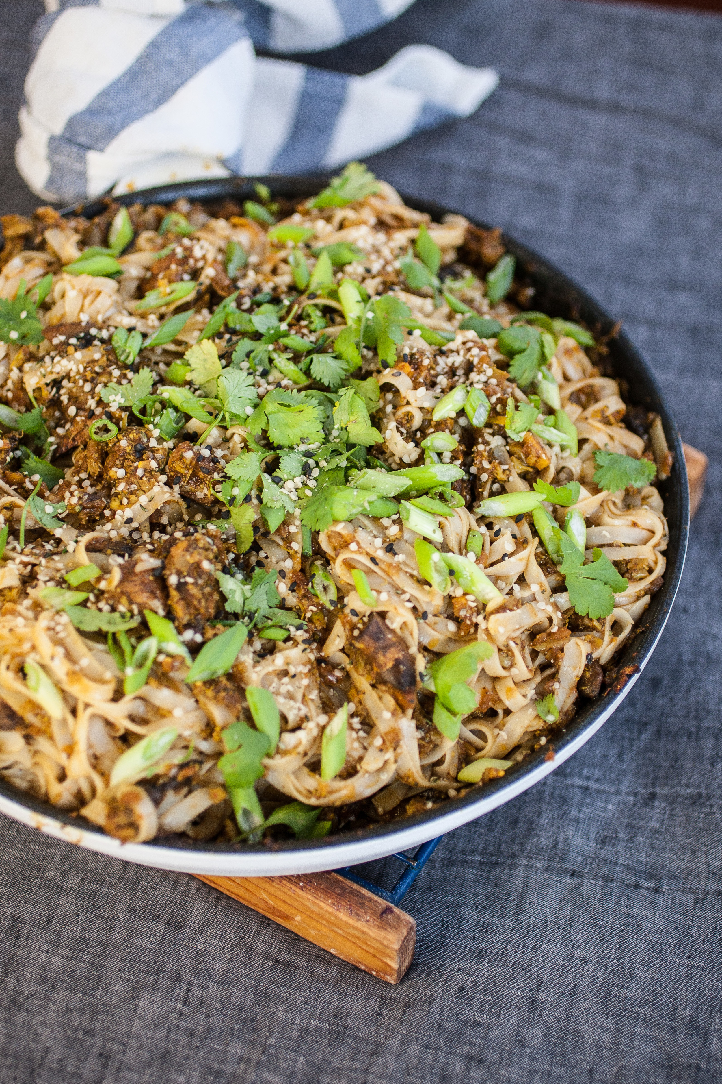 Produce On Parade - Curried Noodles - Chewy rice noodles coated in a zesty curry sauce paired with savory minced broccoli and mushrooms, with a little spicy Thai kick!