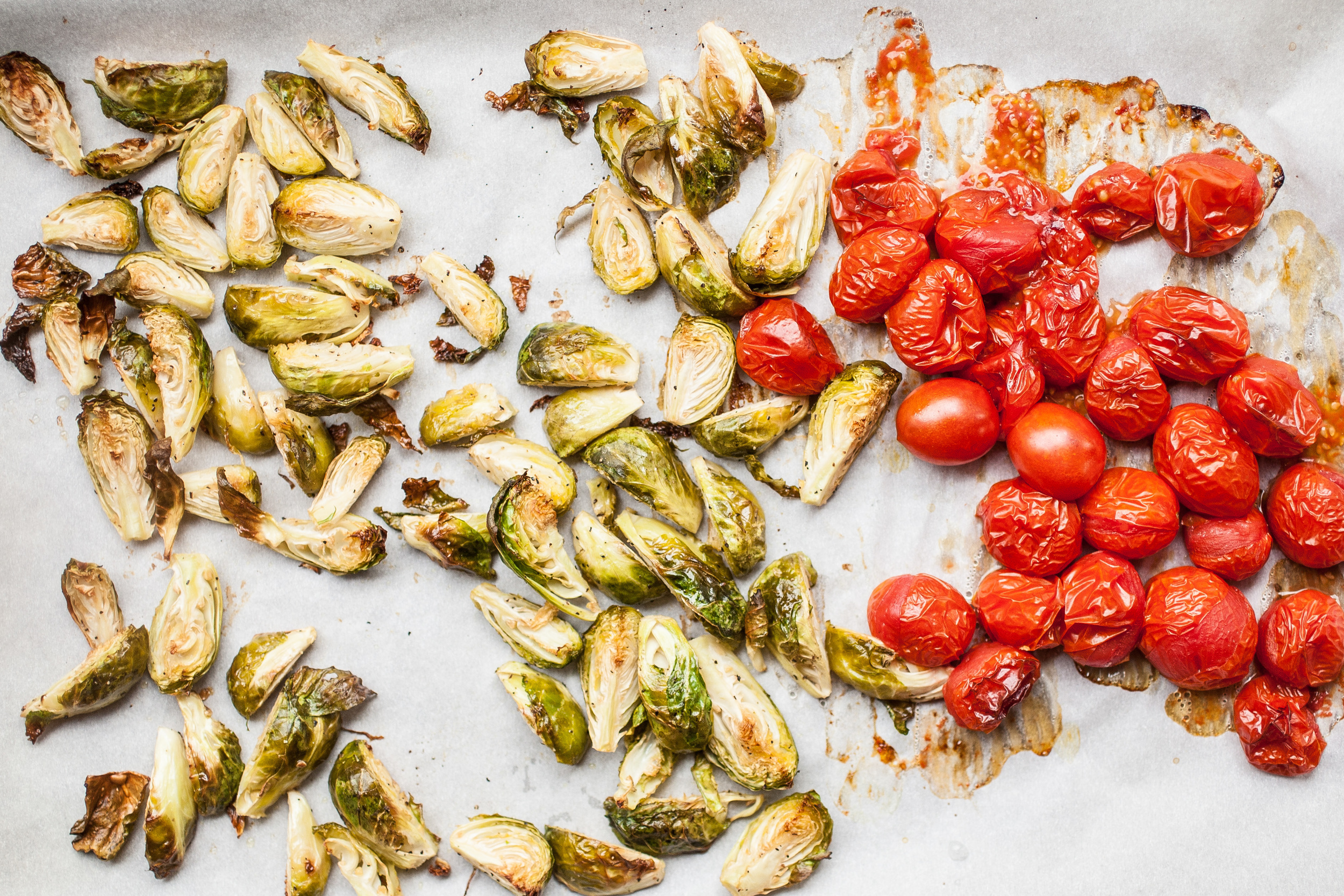 Produce On Parade - Roasted Brussels Sprouts & Bursted Cherry Tomato Spaghetti - This is an easy, hands off meal that's done in 45 minutes top to bottom. Sweet, roasted Brussels sprouts and tart, oven-bursted cherry tomatoes tangle with spaghetti in a cheesy, buttery sauce. Make the most of those veggies that quickly move past their prime with this delicious pasta dish!