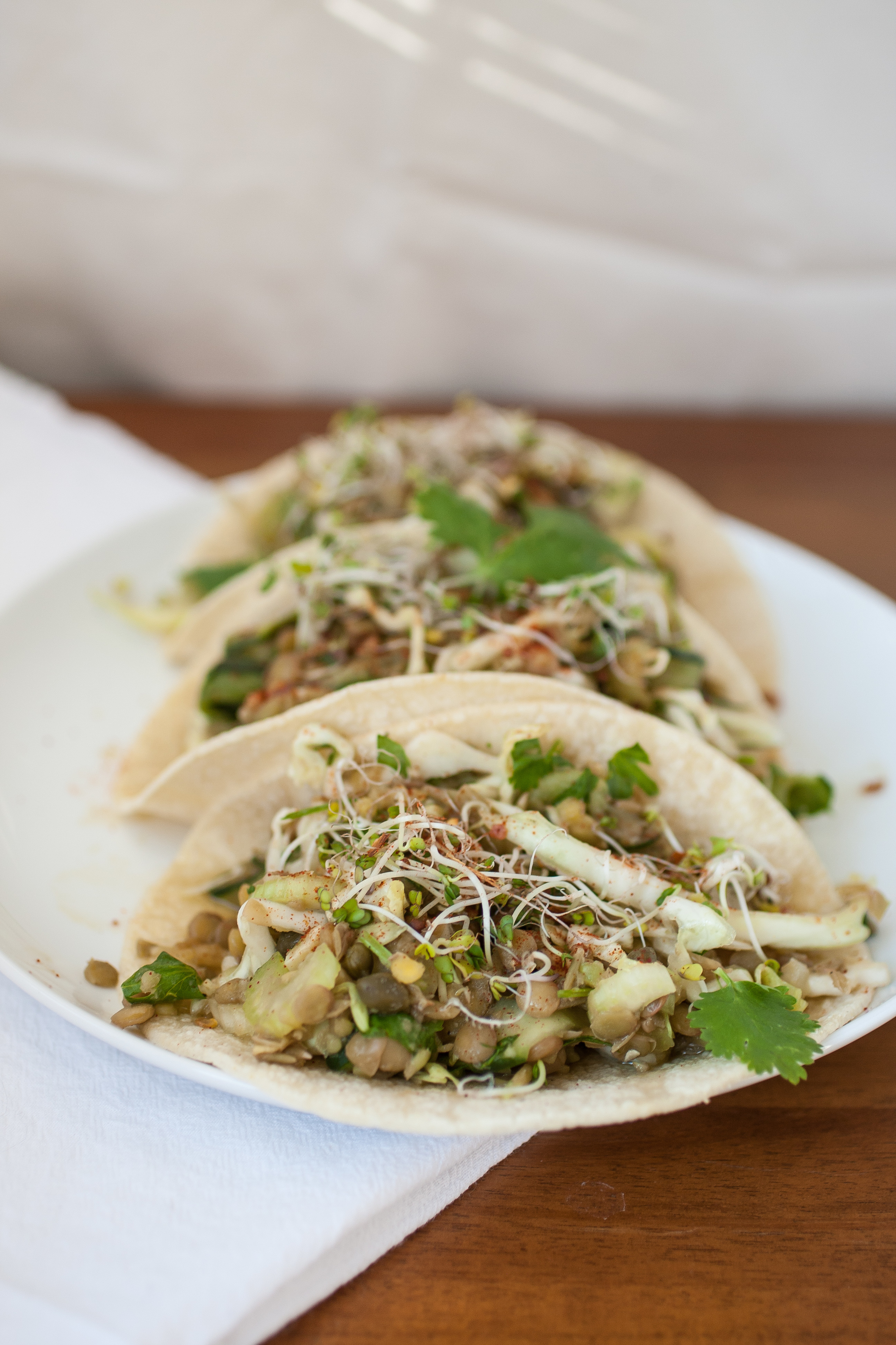 Produce On Parade - Lentil Salad w/ Cucumber & Cabbage - This is a hearty lentil salad filled with refreshing cucumber, crunchy cabbage, celery, and pepitas. It cooks up in 30 minutes flat and is a great as a side, abed leafy greens, or used as a filling in corn tortillas!