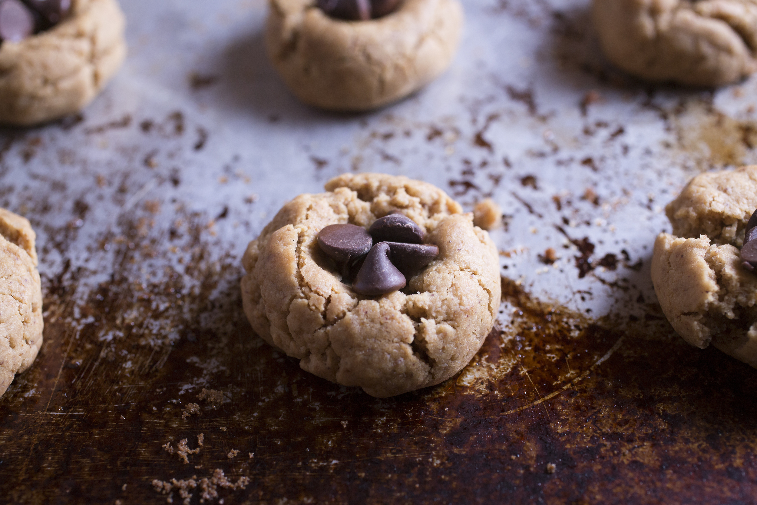 Produce On Parade - Less-Sugar Peanut Butter Blossoms  - A personal holiday favorite, I've finally veganized this scrumptious little cookie. Vegan chocolate chips replace Hershey kisses and are enveloped by a soft and pillowy peanut butter cookie. I've made these lower-sugar using erythritol, but feel free to use regular sugar if you wish. They're easy, done in a flash, and perfect for cookie exchanges!