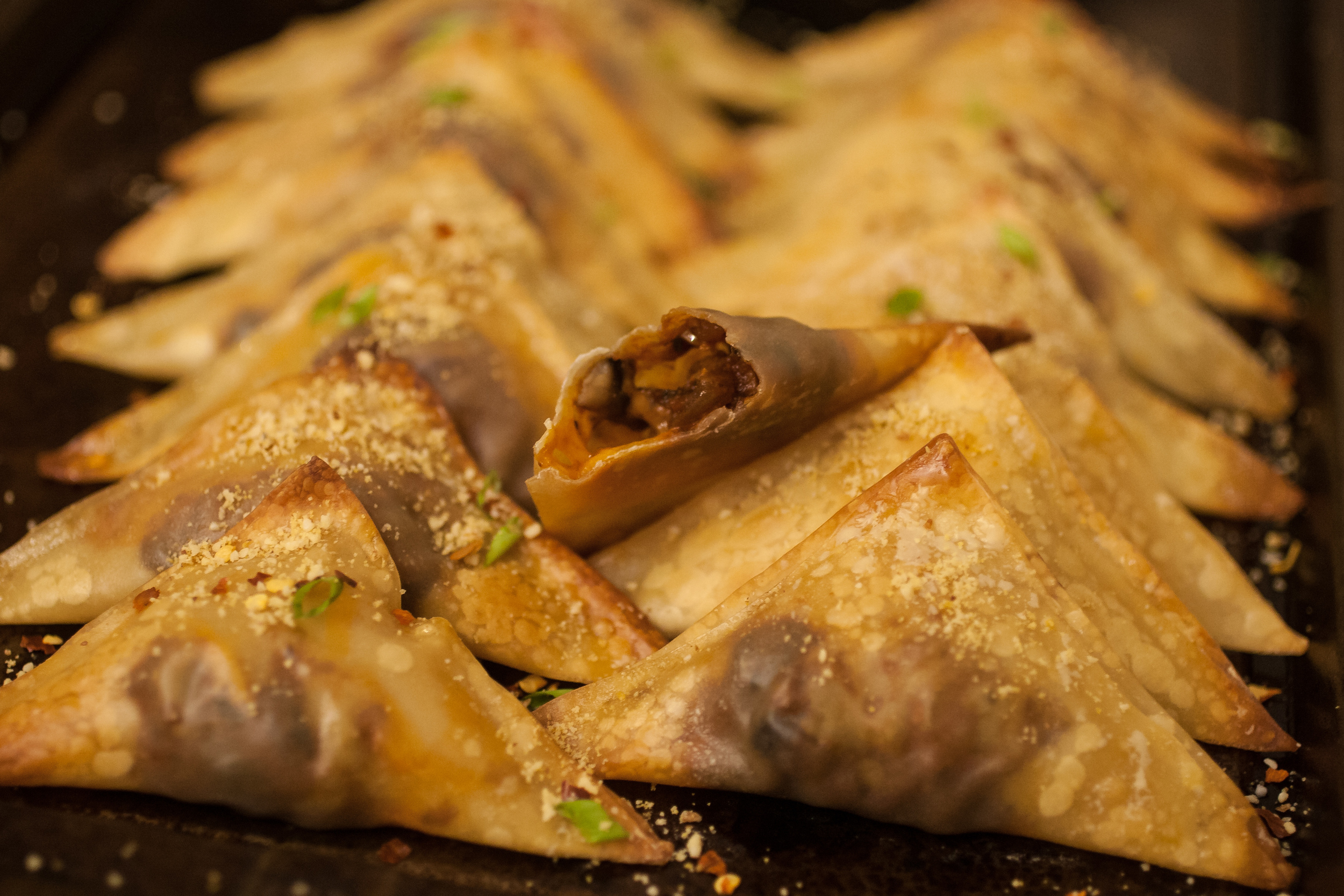 Produce On Parade - Easy Pizza Gyozas - Easier than pizza, healthier than pizza, and way more fun than pizza, these baked gyozas are a super hit! They make wonderful vegan appetizers; your carnivorous Super Bowl buddies will love them. No cruelty necessary.