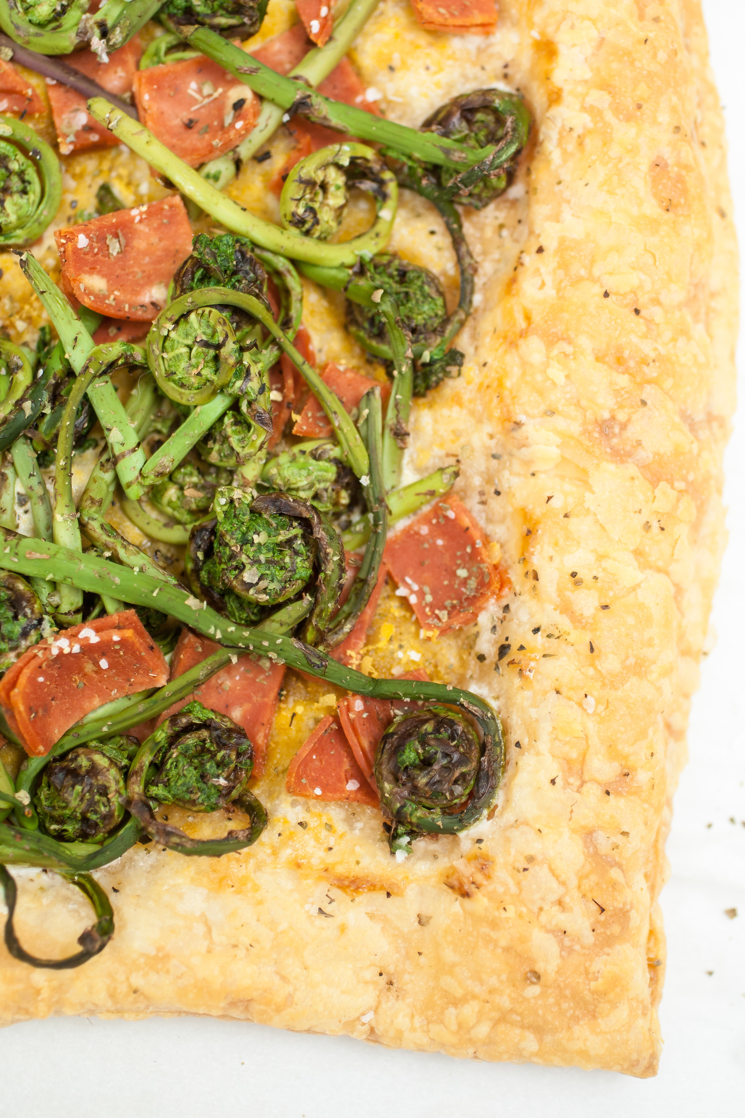 Flaky puff pastry is slathered with ranch dressing and then loaded with fresh fiddlehead ferns and vegan salami. Baked to a golden-brown, this tart is perfect for a light meal or appetizer. It's sure to be a hit among those that are veg-friendly and meat-eaters as well.