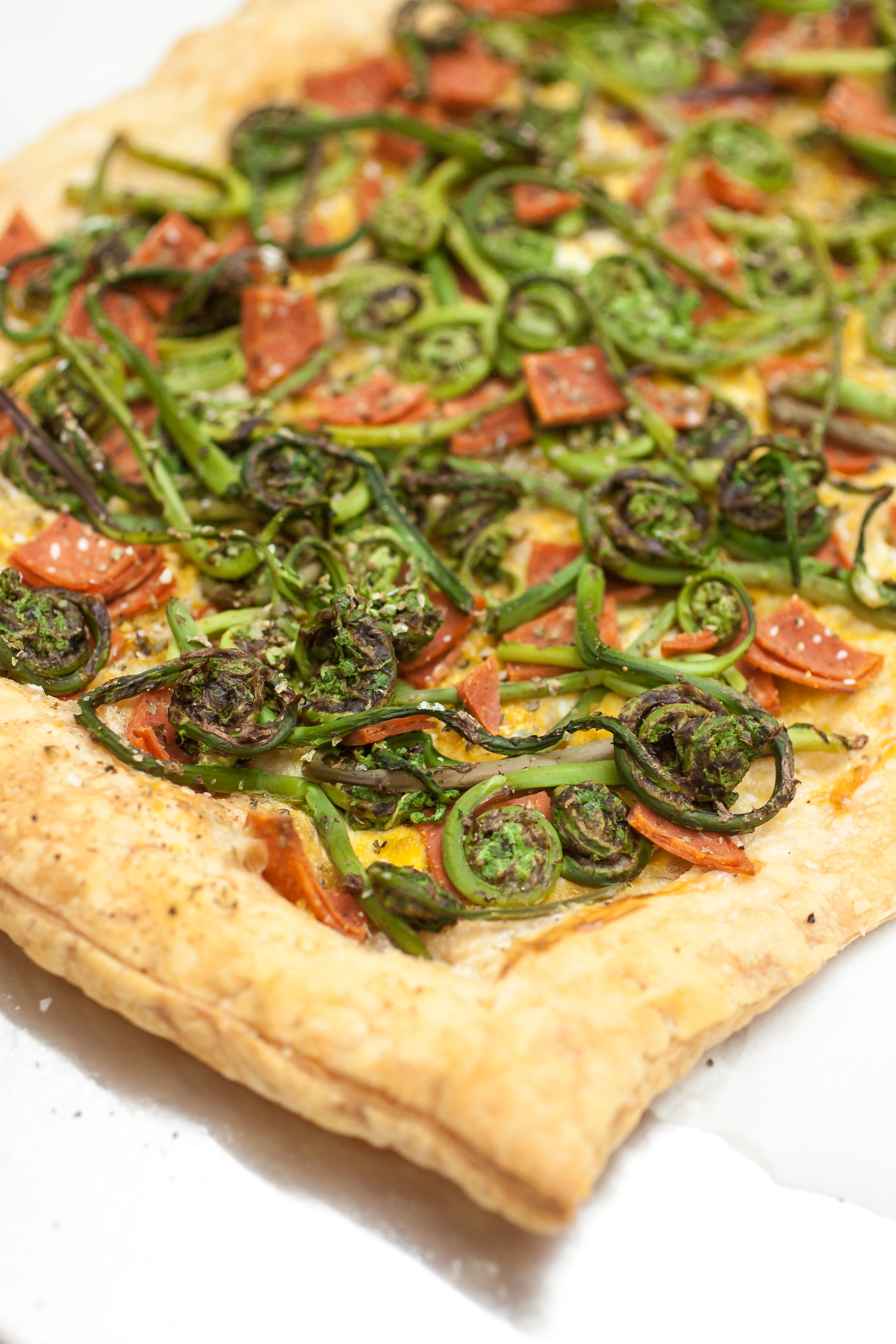 Produce On Parade - Ranch Fiddlehead & Salami Tart - Flaky puff pastry is slathered with ranch dressing and then loaded with fresh fiddlehead ferns and vegan salami. Baked to a golden-brown, this tart is perfect for a light meal or appetizer. It's sure to be a hit among those that are veg-friendly and meat-eaters as well.