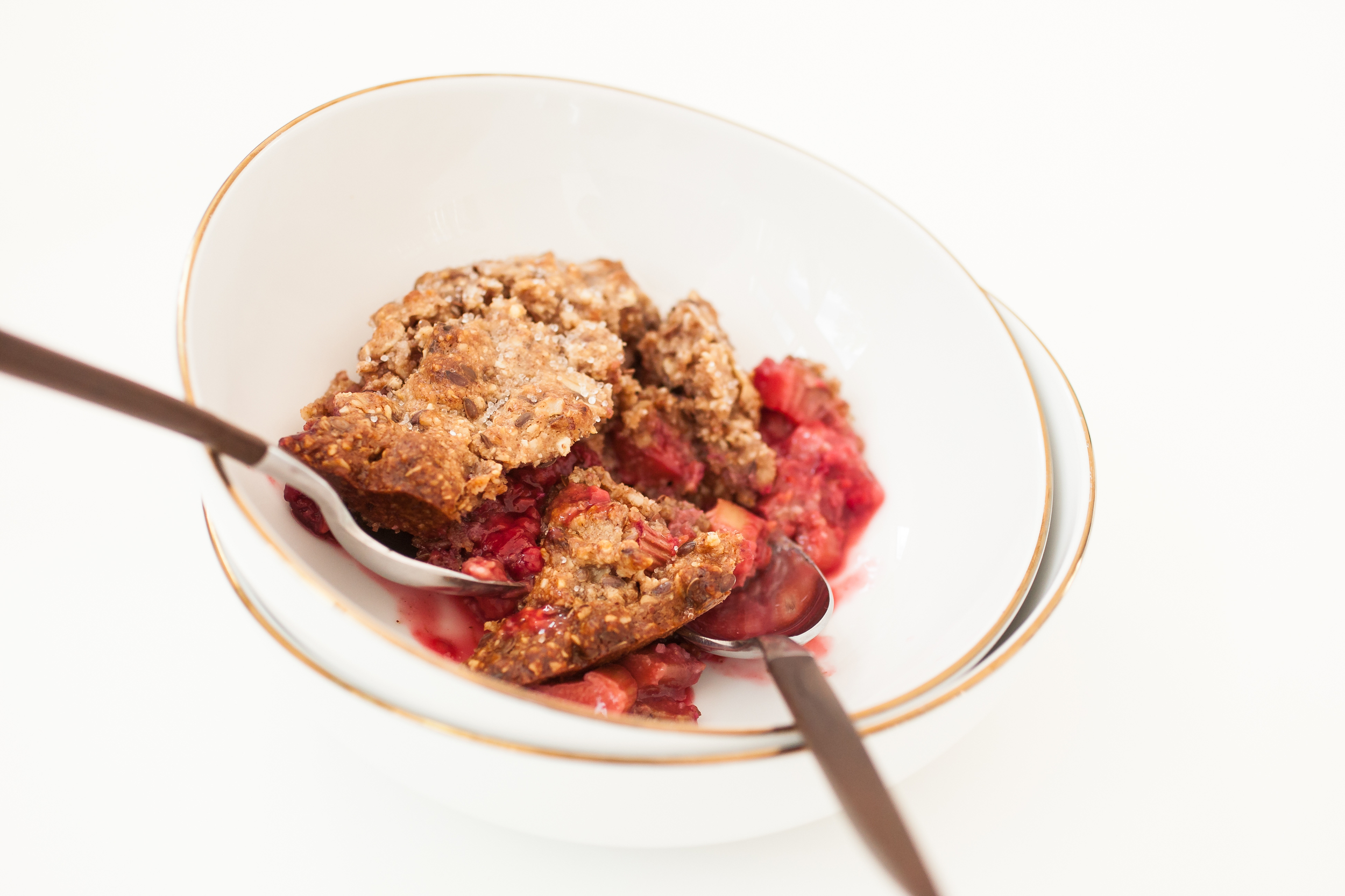 Produce On Parade - Rhubarb & Raspberry Nut Crisp - Taking advantage of the backyard bounty, this is healthy and deliciously tart and sweet crisp is a breeze to whip up. Oats and nuts lend their nutrition to make one scrumptious dessert, bursting with sweet and juicy raspberries and puckering rhubarb.