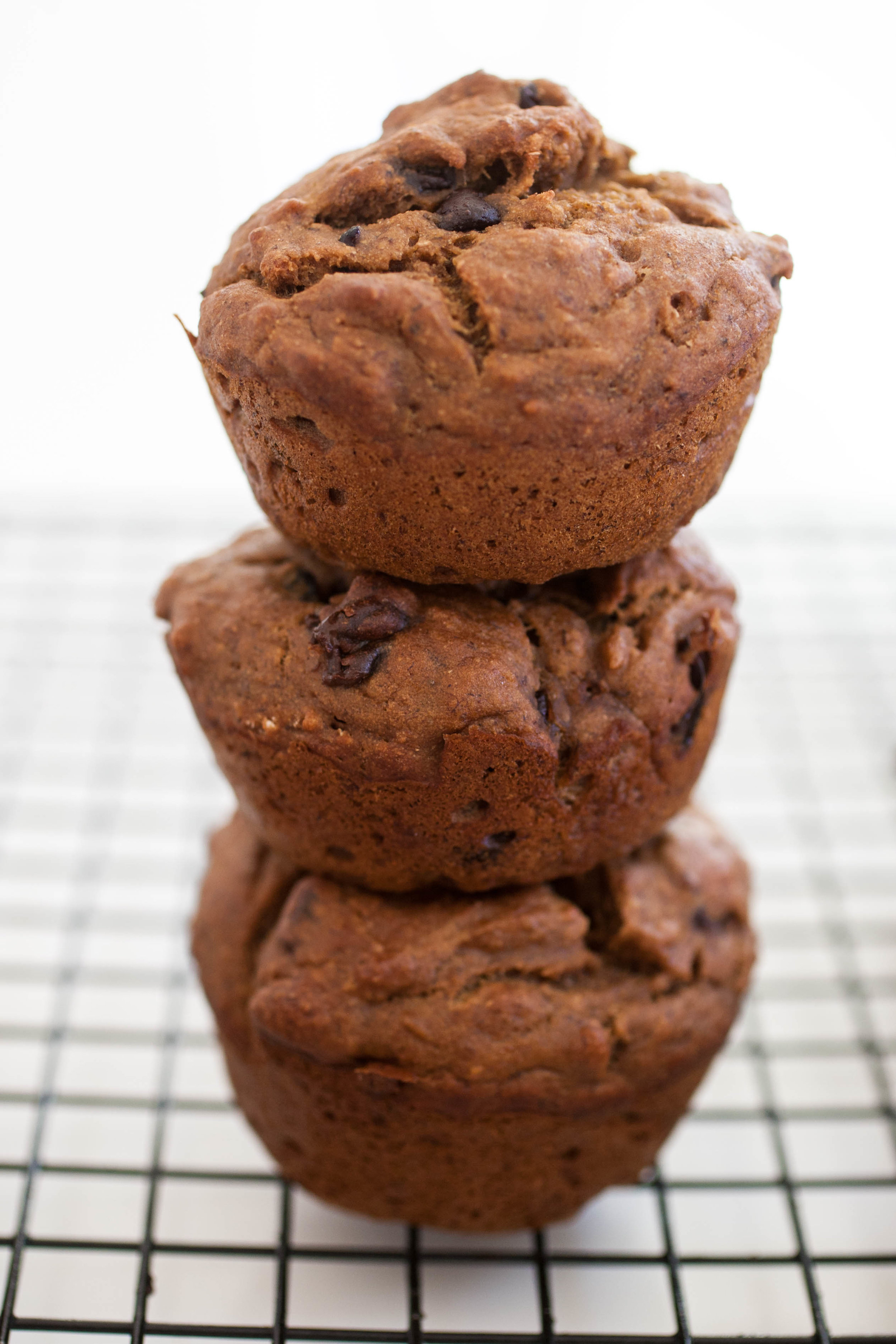 Produce On Parade - Vegan Banana Muffins - This is my go-to, super easy, and quick recipe for vegan banana muffins. These are scrumptious enough to be a treat, but healthy enough to snack on. I like to use a combination of flours such a spelt and sorghum, and toss in chocolate chips and dried cranberries; but feel free to add in whatever you like. This recipe is very adaptable. I freeze leftovers for breakfast during the week!