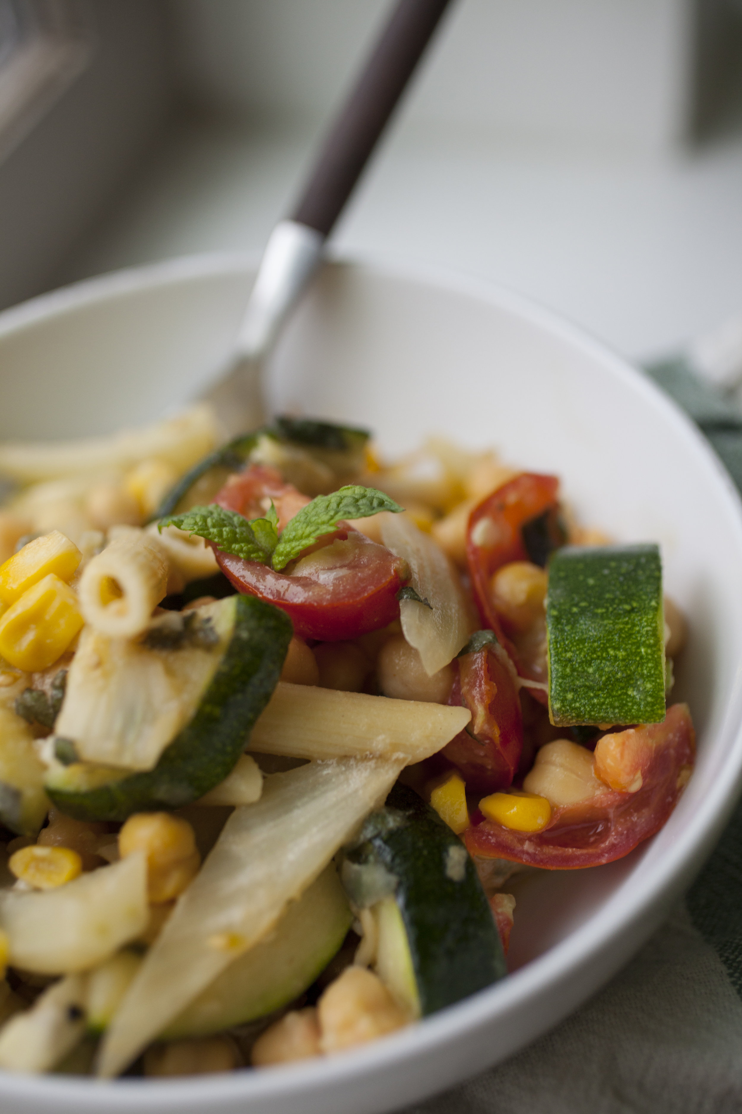 CSA Fennel, Zucchini, & Tomato Pasta - Produce On Parade - CSAs are wonderful, but if you're not exactly sure what to do with fennel, armed with an abundance of zucchini and tomatoes, they can be overwhelming. This delicious pasta dish makes use of three CSA items (we had fresh mint in ours so that makes four!) in spectacular fashion. Sweet, roasted fennel and zucchini blend with umami miso and nutritional yeast and tart cherry tomatoes for a lovely summer pasta dish.