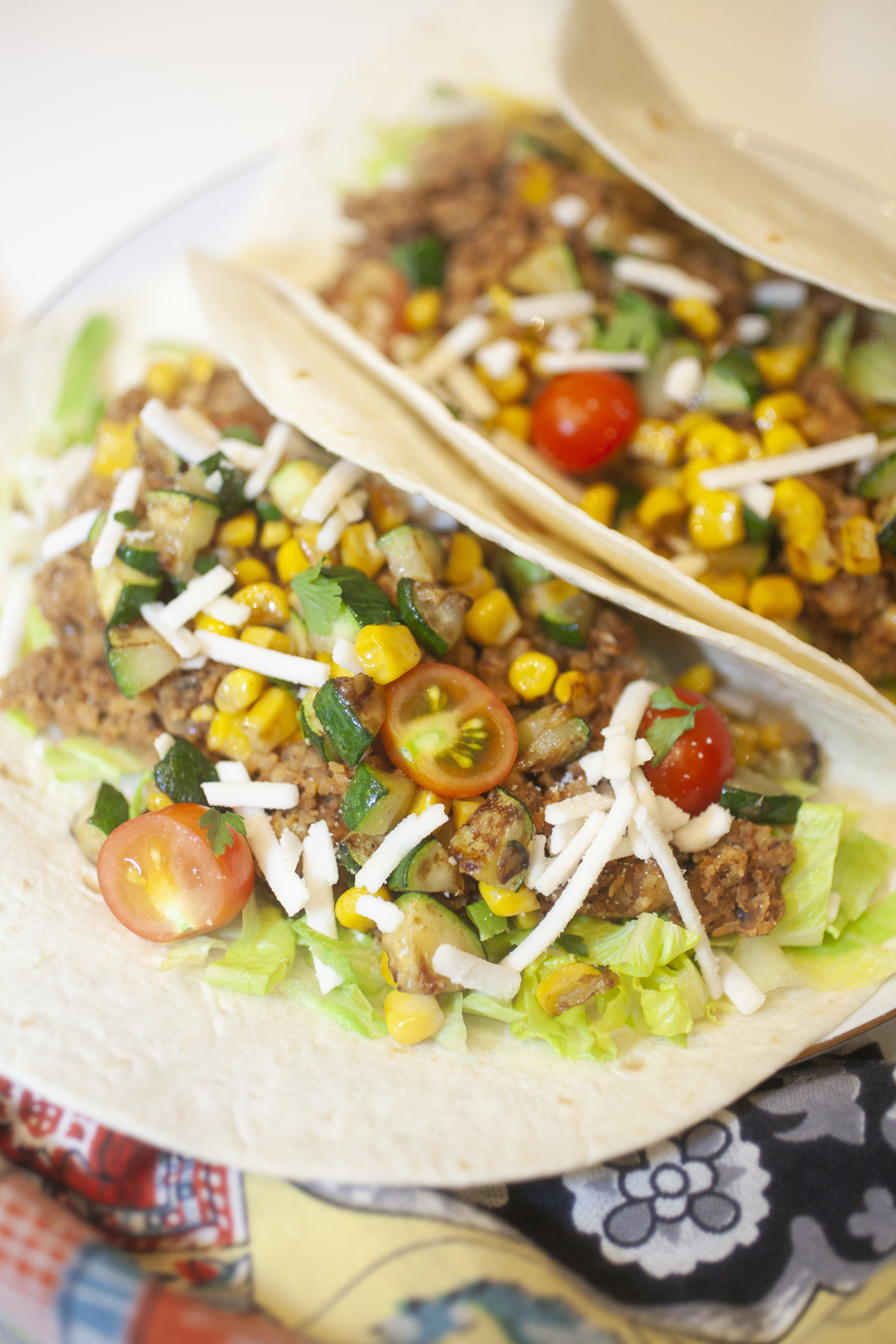 Corn & Zucchini Tacos with Chickpea & Walnut 'Meat' - Produce On Parade - This is one of the best weeknight meals around, vegan or otherwise! These tacos are super fast, healthy, there's very little prep, everyone loves them, the tacos are customizable to tastes, and they leave little cleanup. A giant win in my book!