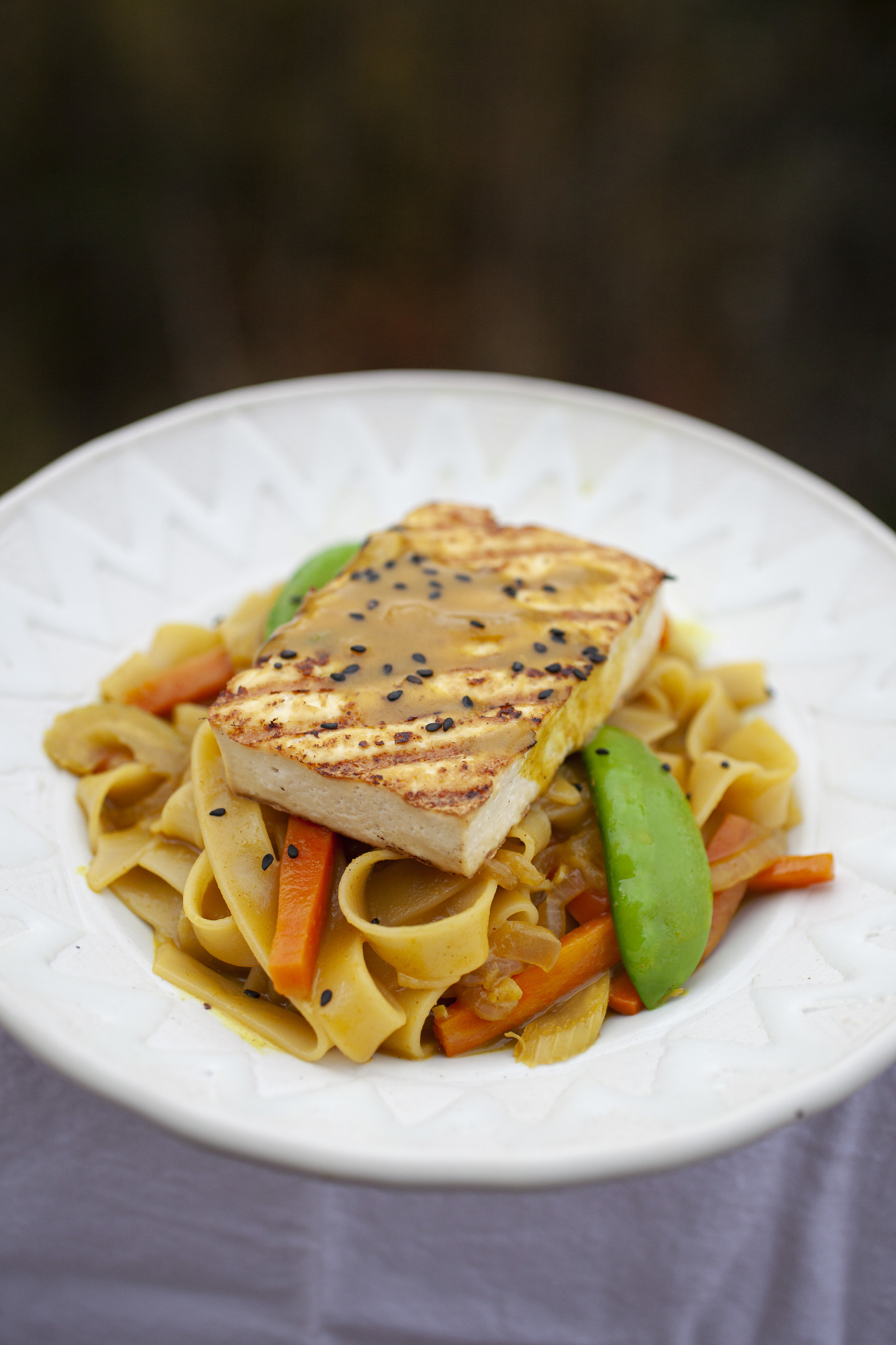 Produce On Parade - Thai Curry Turmeric Rice Noodles w/ Grilled Tofu - Rice noodles and sauteed veggies simmer in a deliciously creamy, coconut Thai curry turmeric sauce topped with grilled tofu. A hint of sweetness and spice, this is a super fast and easy dish that's perfect for a weeknight.