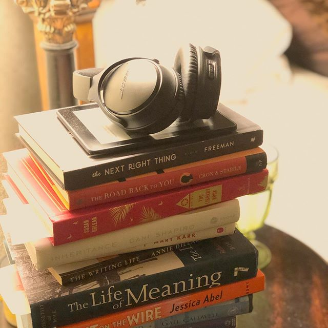 I love a tower of books by my bed. And headphones for all my podcast love. And a Kindle for reading in the dark. A tangible security blanket stack.