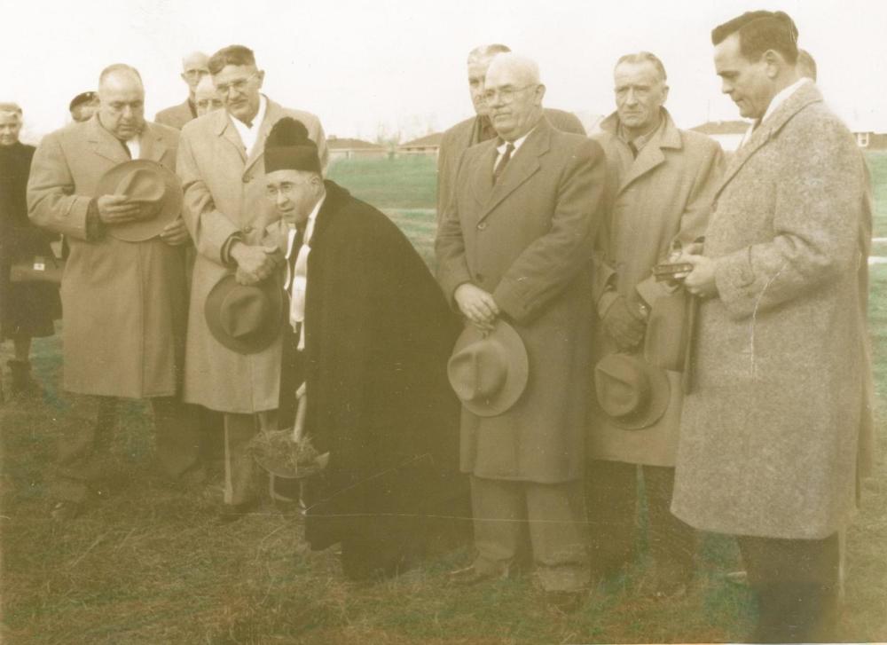 Fr. John McDuffee breaks ground on the site of St. Pius X parish on January 1, 1956