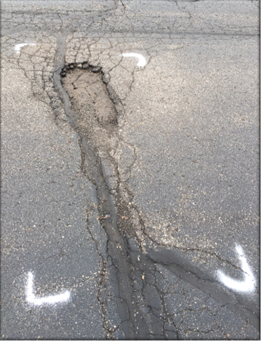 A pothole from the parking lot