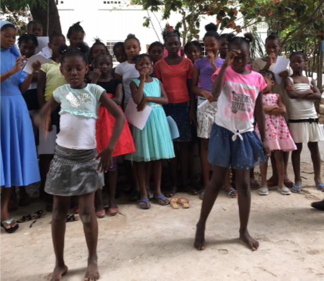 GIRLS AT HOME—The young orphans perform a dance for in gratitude for the house we helped purchase through our parish tithe.