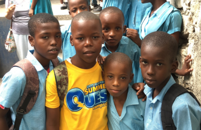 BOYS AT SCHOOL — These guys were happy to pose after class St. Alphonsus School, which also gets our financial support.