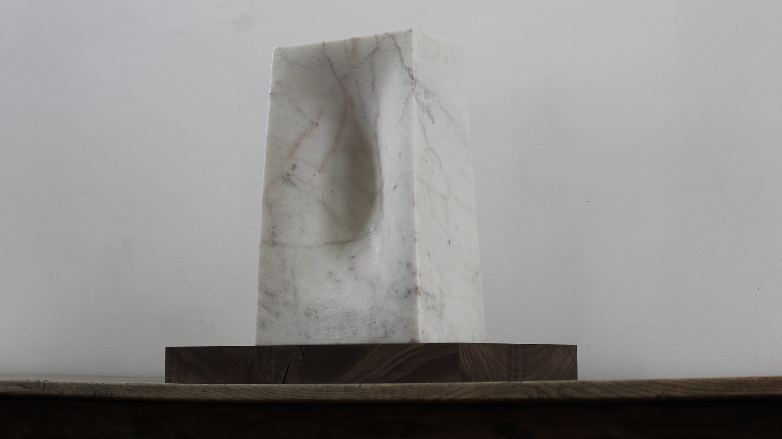 The Hint, Marble on chestnut base.