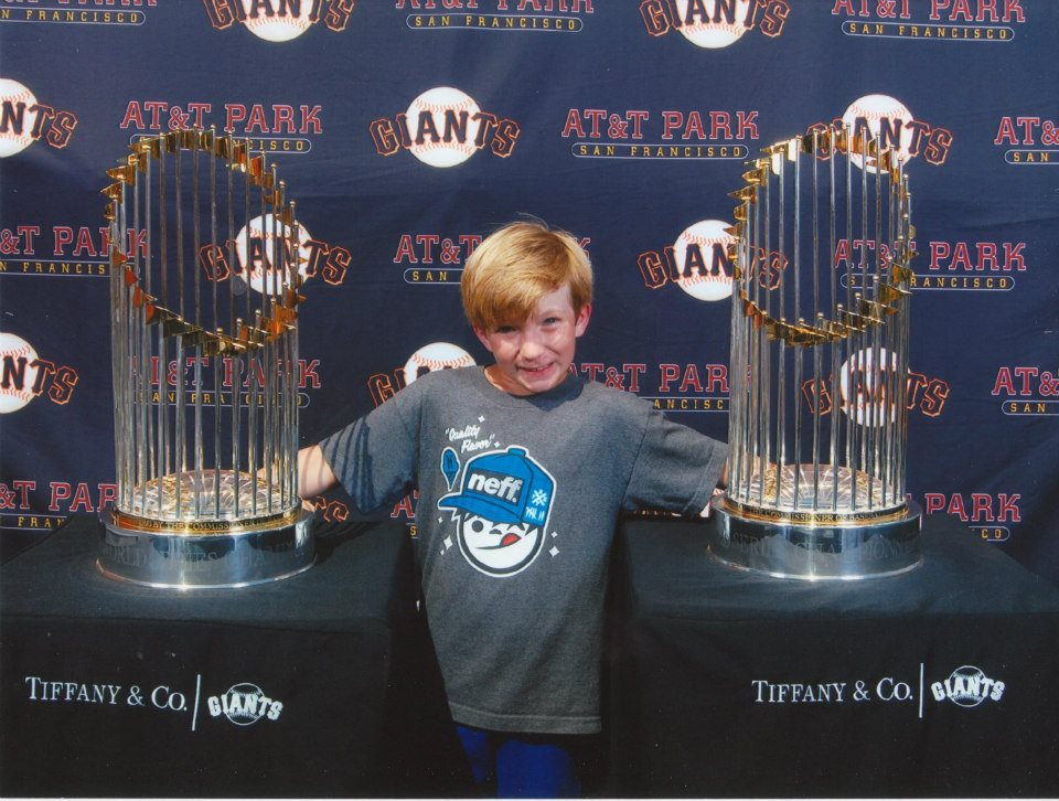 Liam Nelson with the World Series Trophies