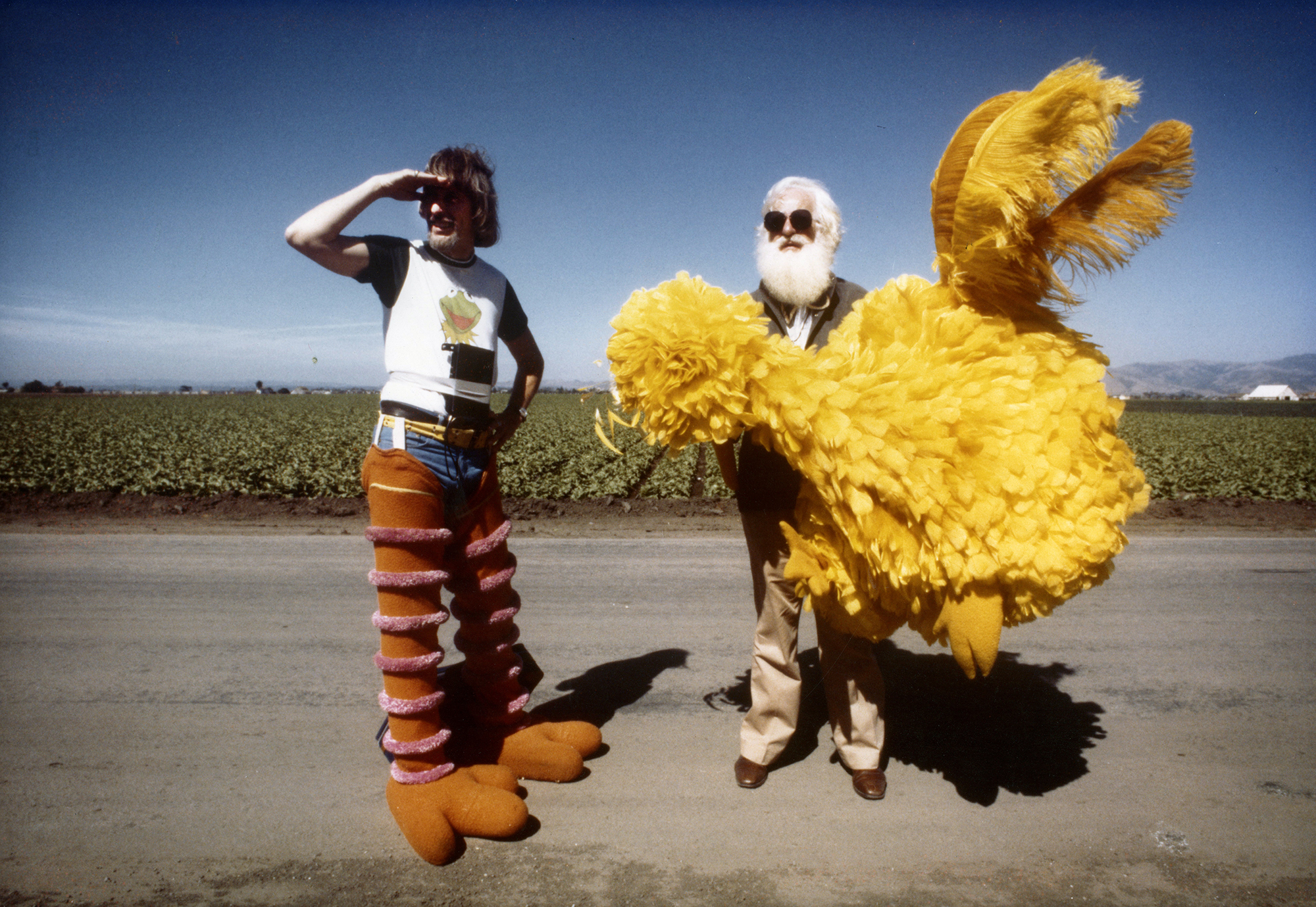 Archival photo of Caroll Spinney and Kermit Love on the set of a Sesame Street production. Photo courtesy of Debra Spinney.
