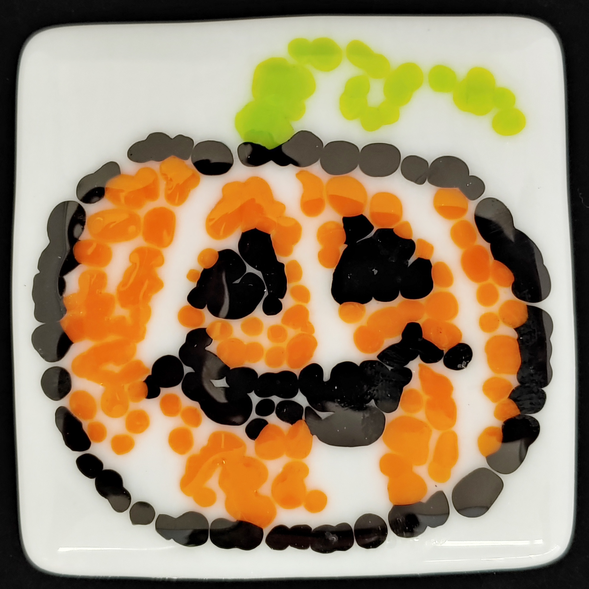 Pumpkins with your pumpkin - October 20, 10:00 AM - 11:30 AMThis is a class made for duos. Perfect for a parent-child duo, or great for a fun date night for first time fusers. In this class we use frit to create the shapes which 1) requires no cutting 2) has no sharp edges, and 3) easily brings images to life. We'll walk you through our tips and tricks when working with frit so that even Charlie Brown is impresses with how great your pumpkins turn out. Featured Project: 2 coaster set Skill: working with frit (fine and course) Ages: All Ages