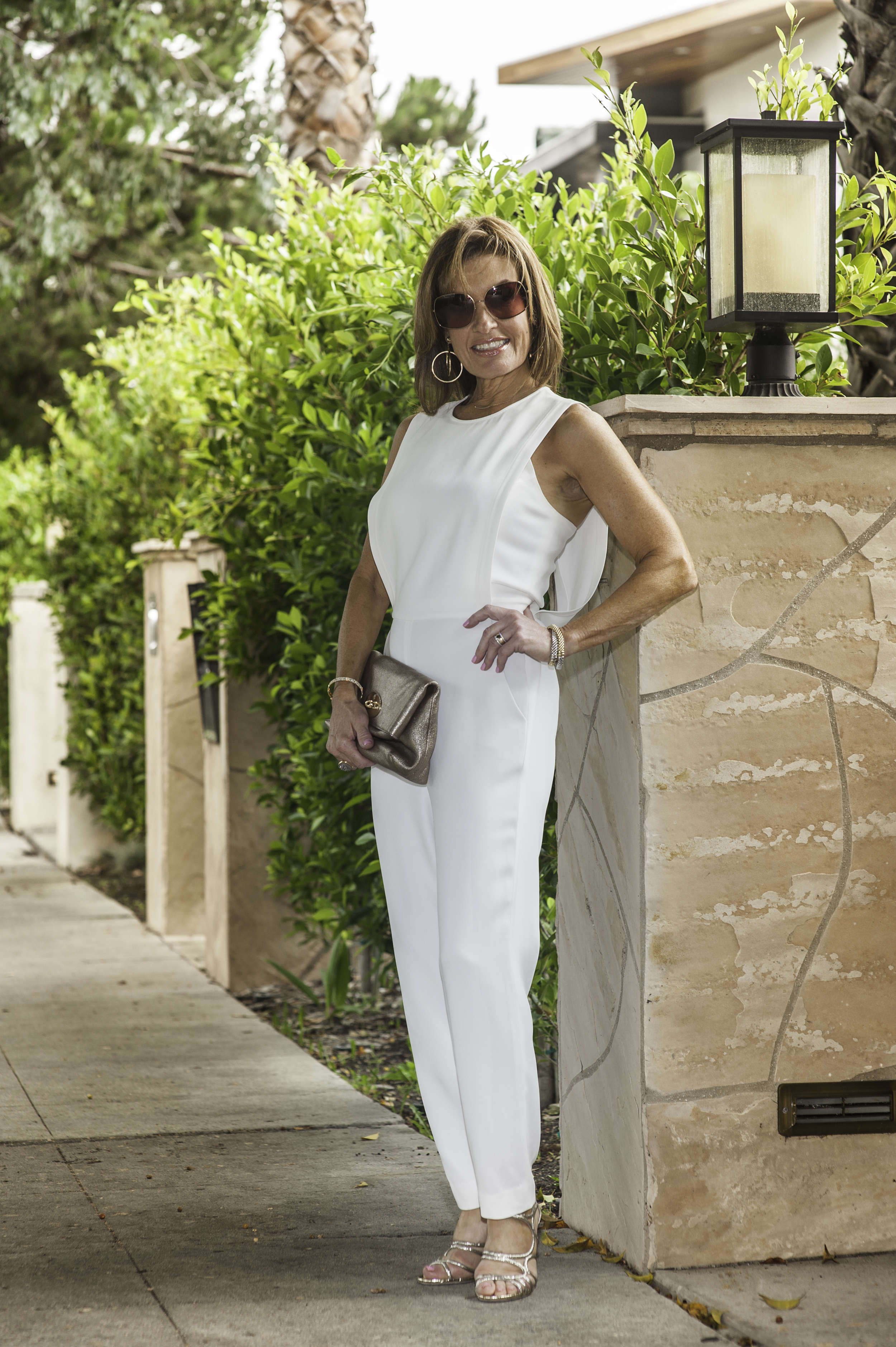 Theory Jumpsuit , similar for less here , Mulberry Clutch, Jimmy Choo Sandals, similar  here .