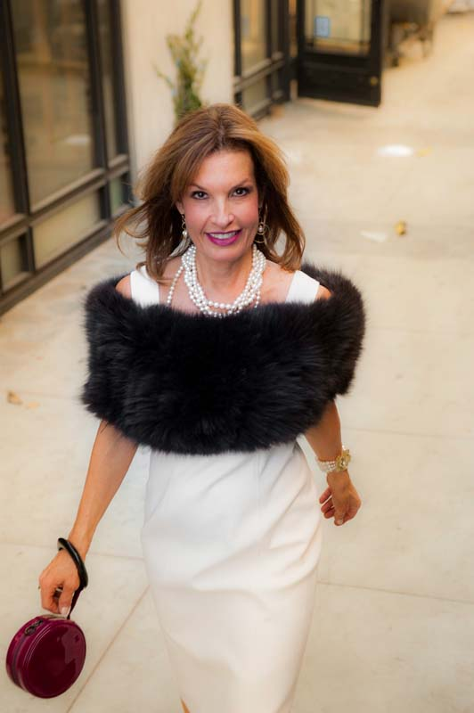 Fox Fur Stole  ,  White Dress  ,  Cocktail Handbag  ; All by  WORTH New York  . Manolo Blahnik Heels.