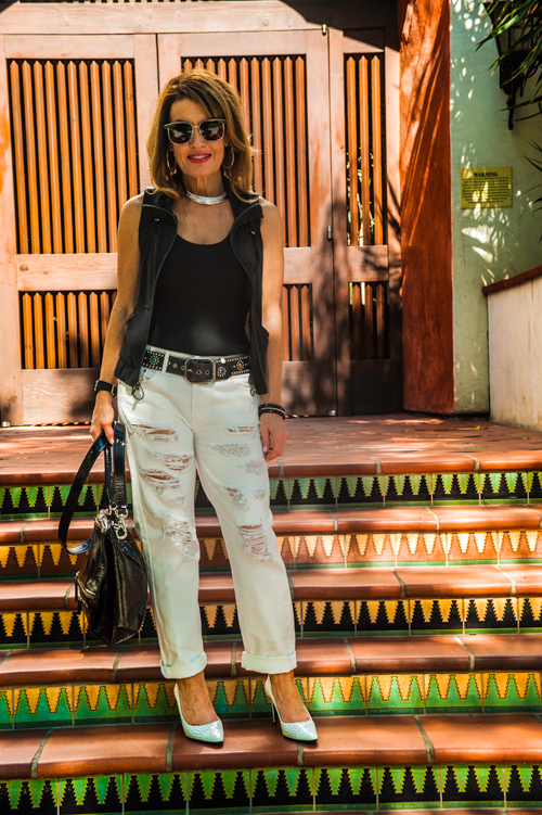 James Perse Tank , Koral Vest and Great China Wall Belt (available at Yellow Dog) Prada Pumps, Citizens of Humanity Jeans,  similar for much less here ,  Givenchy Bag , Caliana Necklace, John Hardy Earrings, also seen  here , Zina Ring, Gucci Watch.