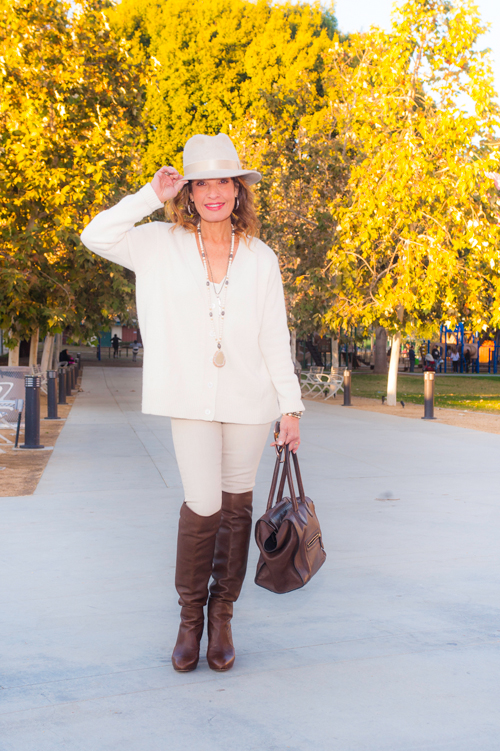 Filuhats  Hat, Co Sweater (available at Savannah Santa Monica), Joie Tank,  AG Jeans  (available at Scoop NYC), Gianvito Rossi Boots, Celine Handbag, Calypso St. Barth Necklaces,  Stone  and Leaf.