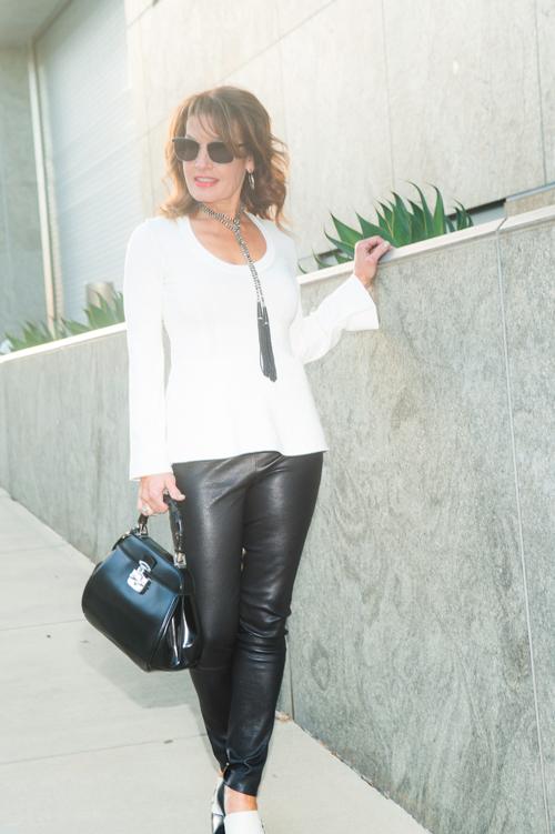 Balenciaga Sweater , The Row Leather Legging,  similar here , Manolo Blahnik Shoes, Gucci Handbag, Diane Cotton Lariat, John Hardy Earrings, Oliver Peoples Glasses.