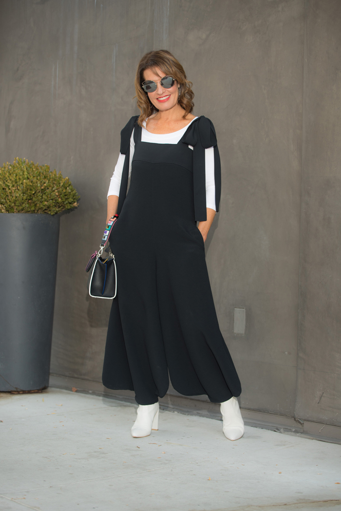 Chloe jumpsuit    similar here   , Wolford top    similar here   ,    Stuart Weitzman boots   , Miu Miu sunglasses, Fendi handbag and strap,    John Hardy hoops   .