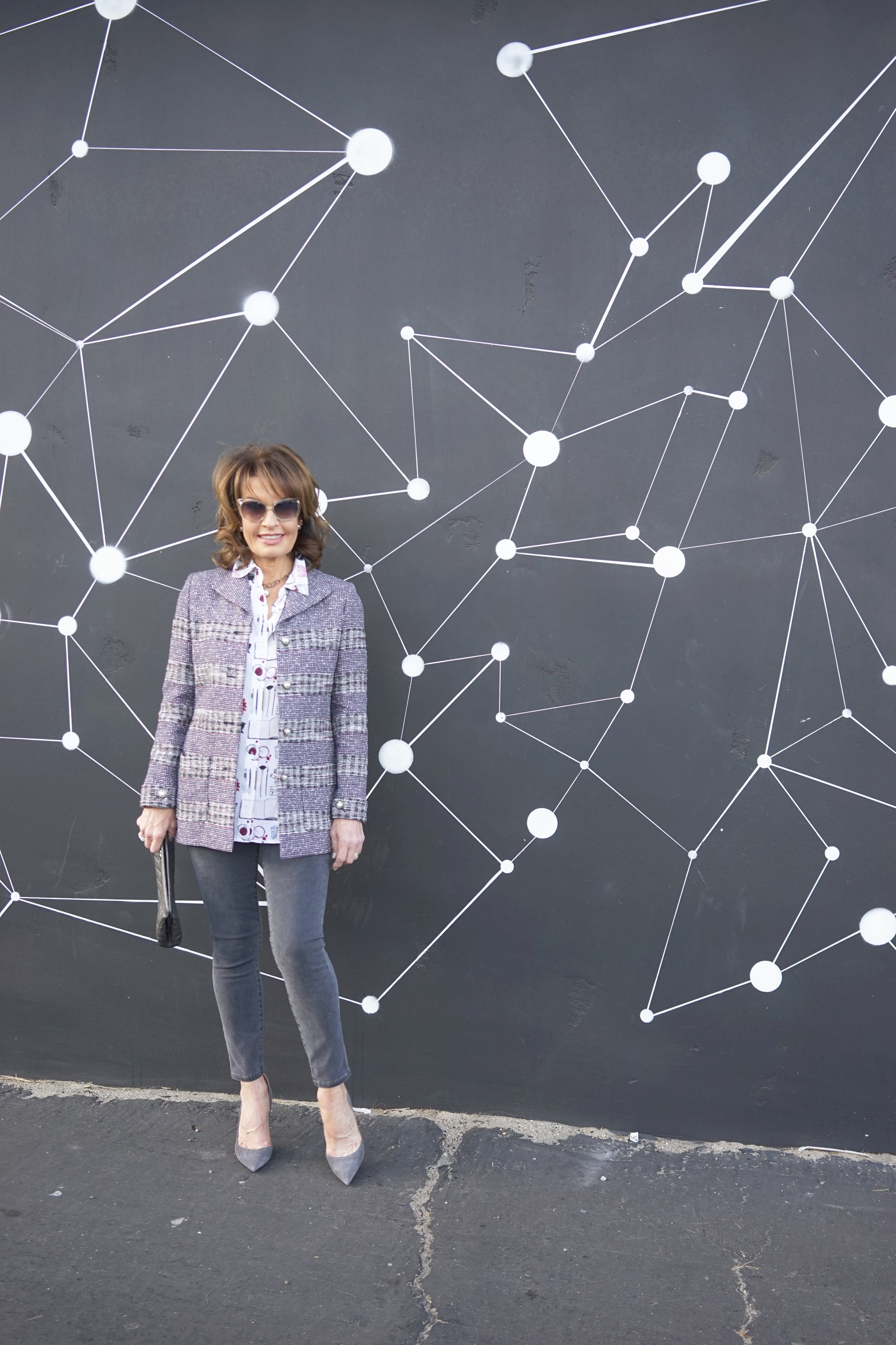 Chanel jacket and clutch,   Equipment blouse, similar here      J Brand jeans   , both also available at    Yellow Dog LA   ,   Gianvanito Rossi pumps,    Christian Dior shades and Tribal earrings.