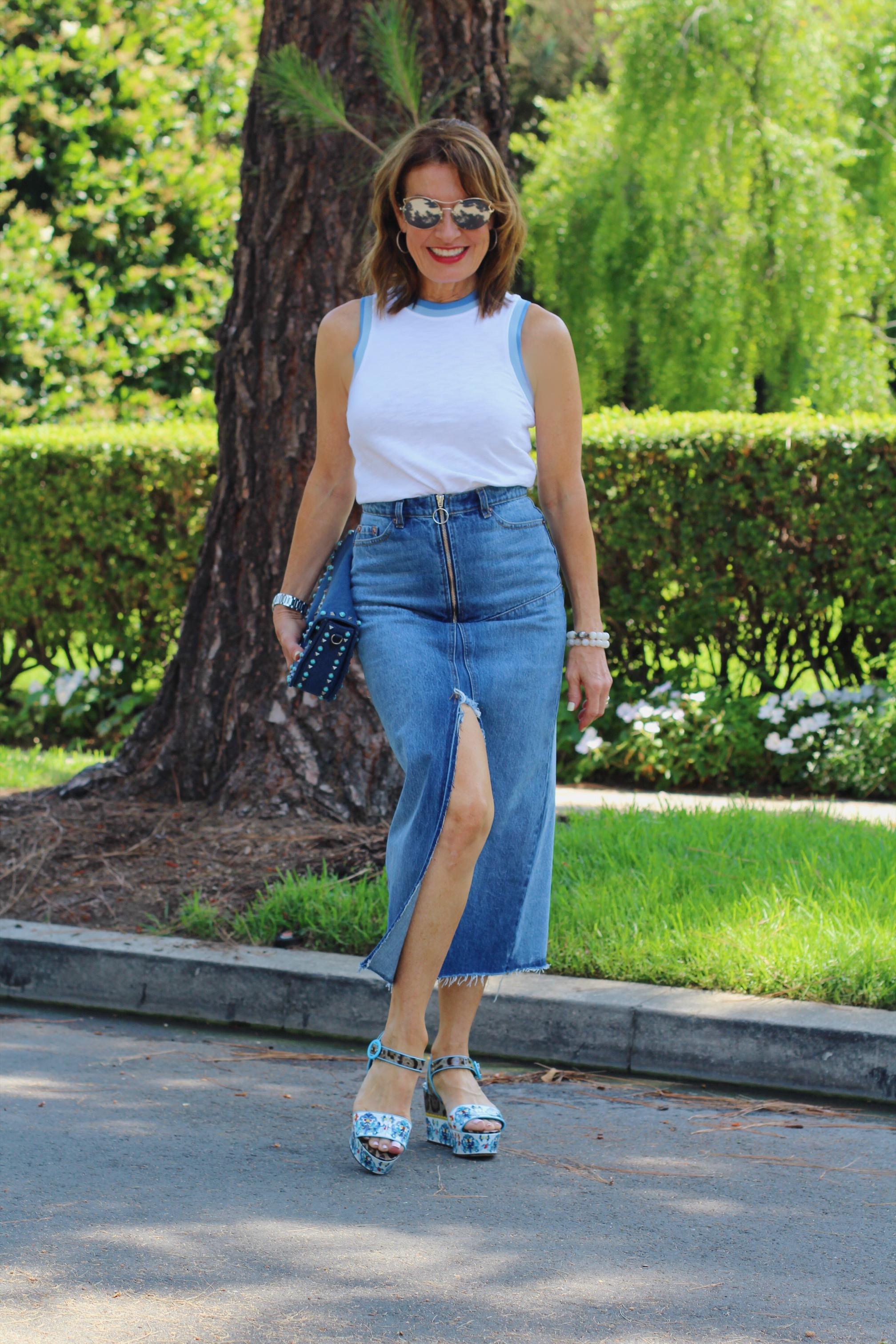 The Kooples denim skirt   ,    Rag and Bone shirt   ,    Dolce and Gabanna sandals   , Valentino handbag, Miu Miu sunglasses, The Jewelry Bar bracelets.